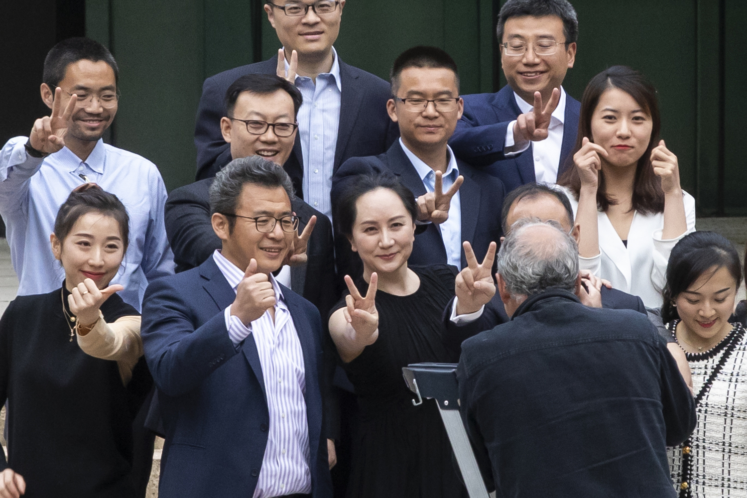 Huawei CFO Meng Wanzhou poses for pictures with friends and supporters on the steps of the B.C. Supreme Court in Vancouver on May 23, 2020. (Ben Nelms/CBC Vancouver)