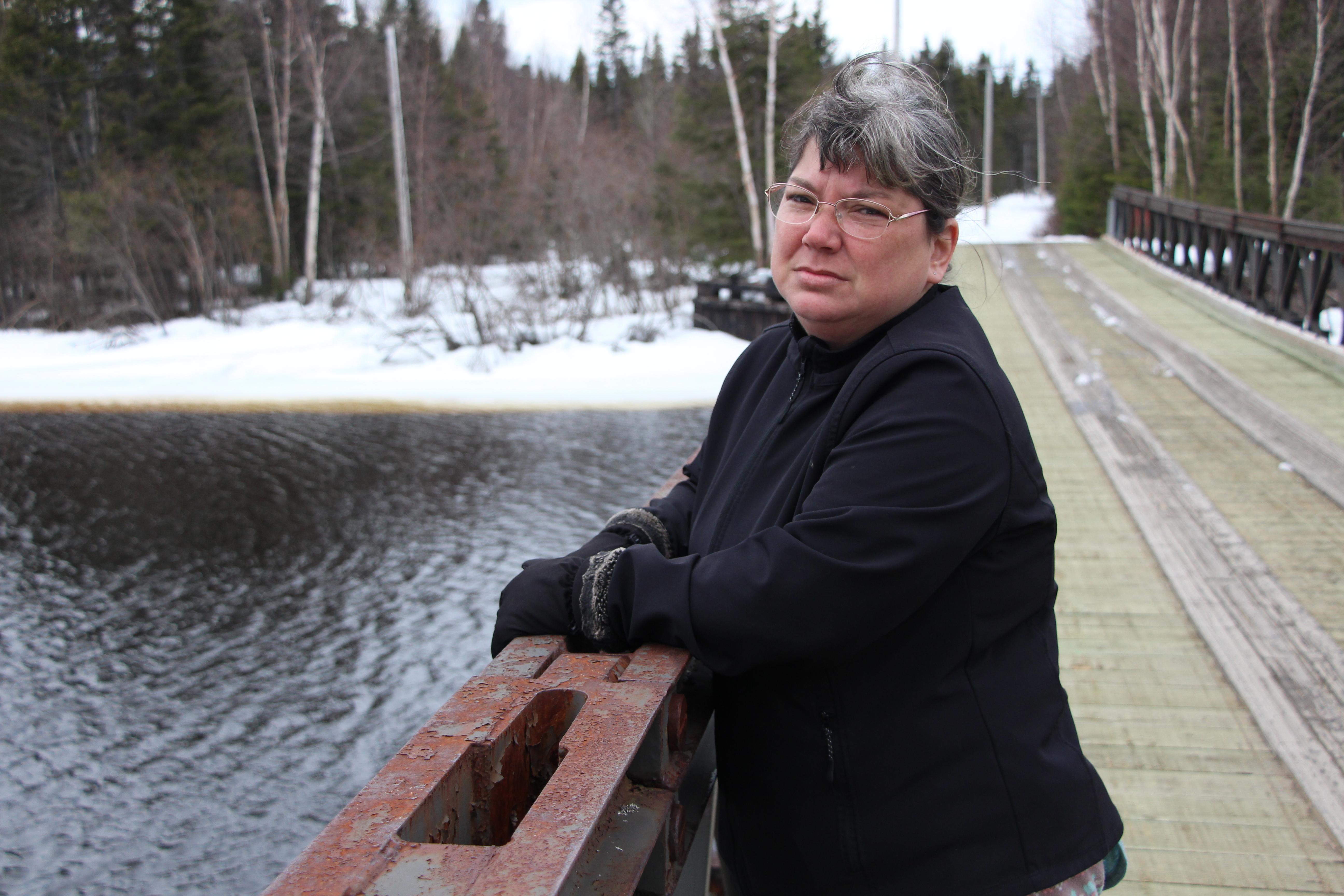 Melissa Best stands on the Wallace McLean Bridge in Mud Lake, Labrador. (John Gaudi/CBC)