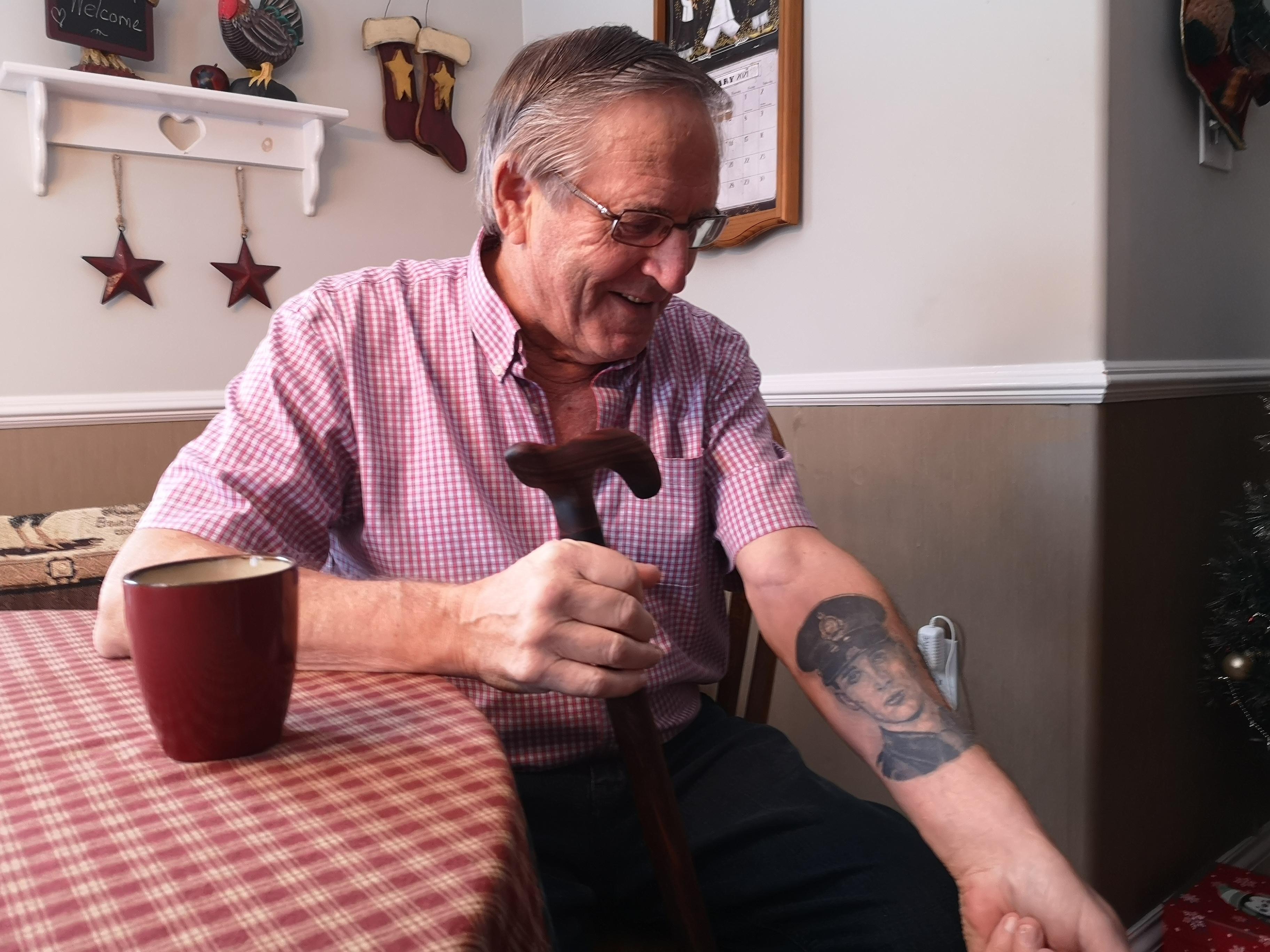 Robert Miller displays a tattoo of his son, Bruce. (Brian MacKay/CBC)