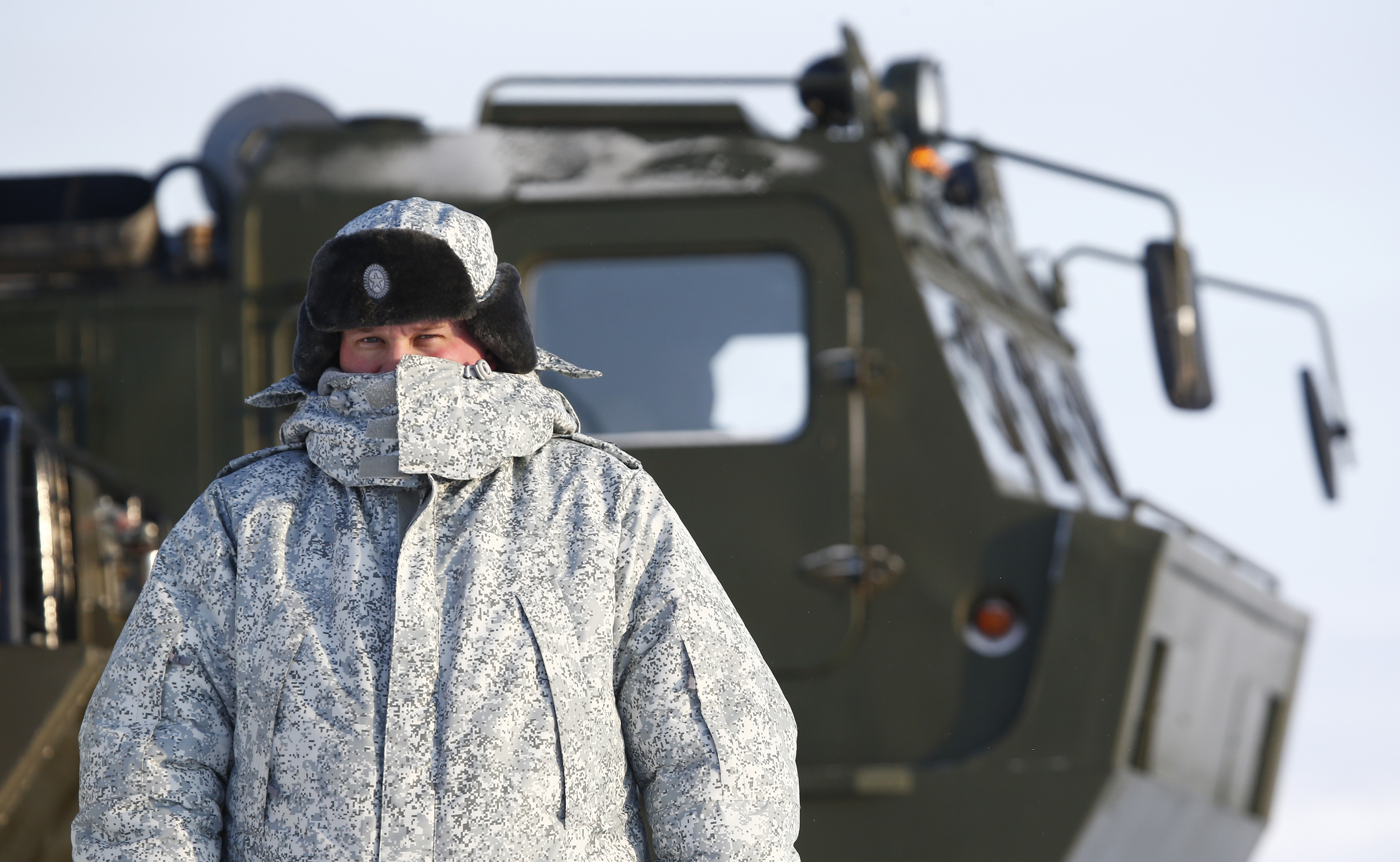 A Russian serviceman stands in front of an off-road military vehicle at the Nagurskoye military base in Alexandra Land on the remote Arctic archipelago of Franz Josef Land. (Sergei Karpukhin/Reuters)