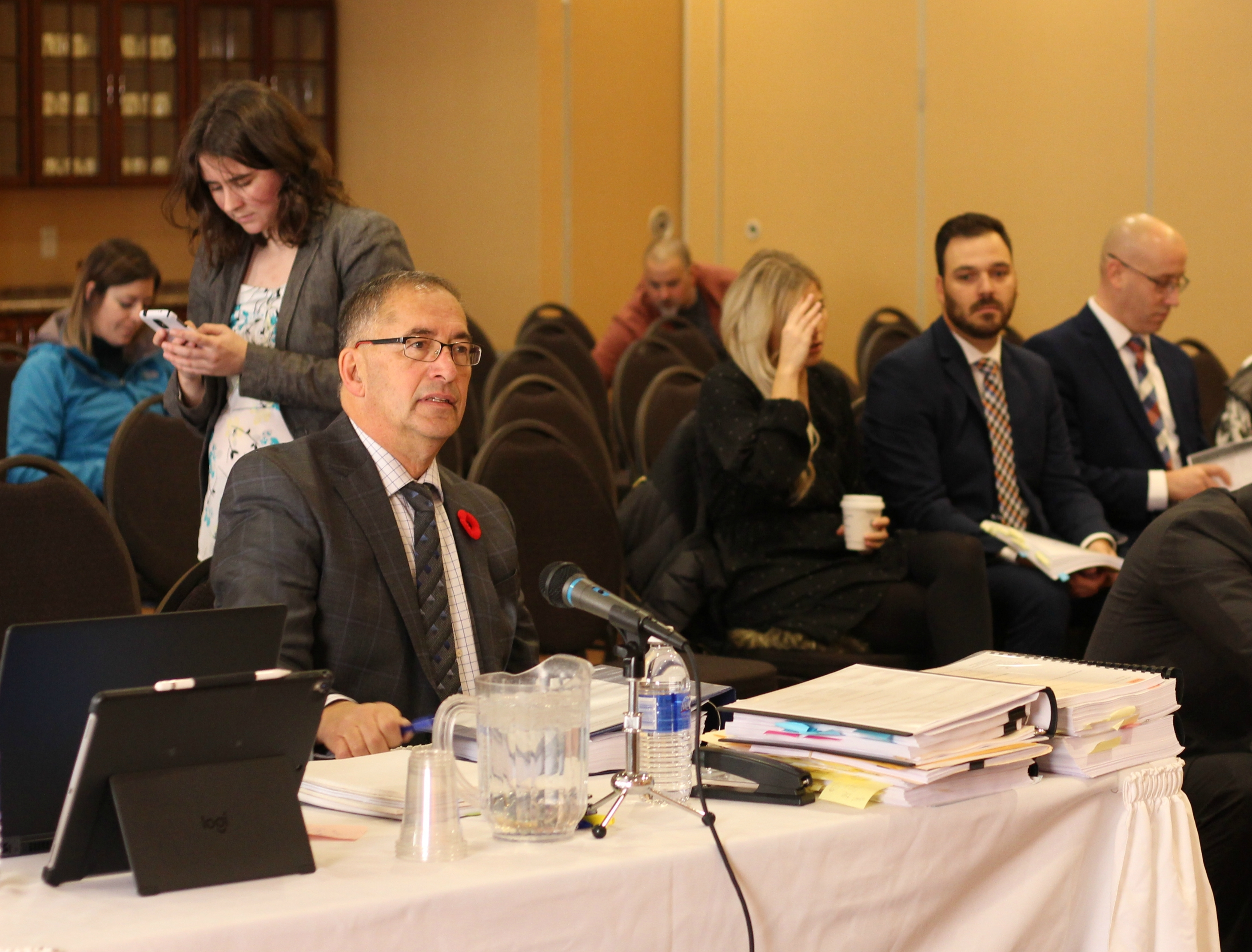 Basile Chiasson, left, is the lawyer representing the Bathurst police chief in a discipline hearing for the two officers. (Shane Magee/CBC)