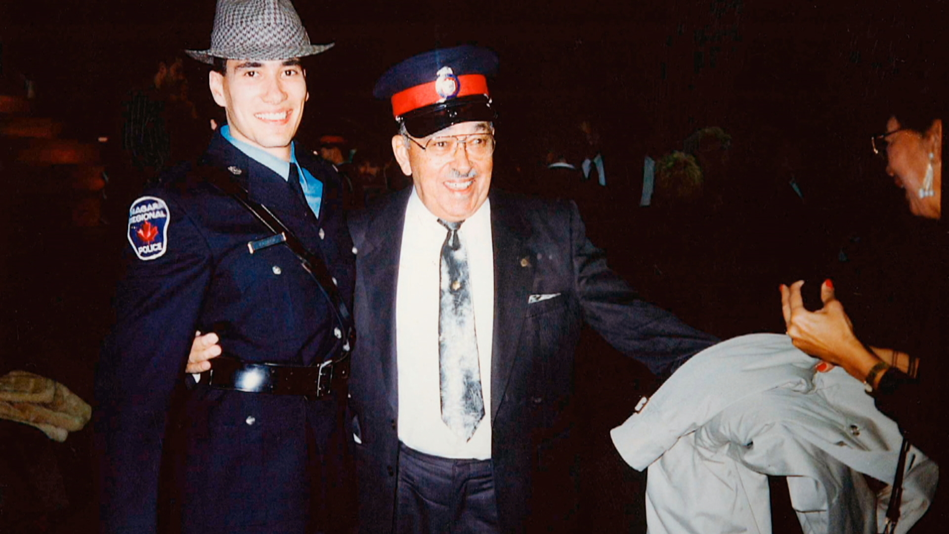 Nathan Parker's grandfather attended his 1990 Ontario Police College graduation and swapped hats with him for this photo, according to Nathan's brother, Phillip Parker. (Submitted by Phillip Parker)