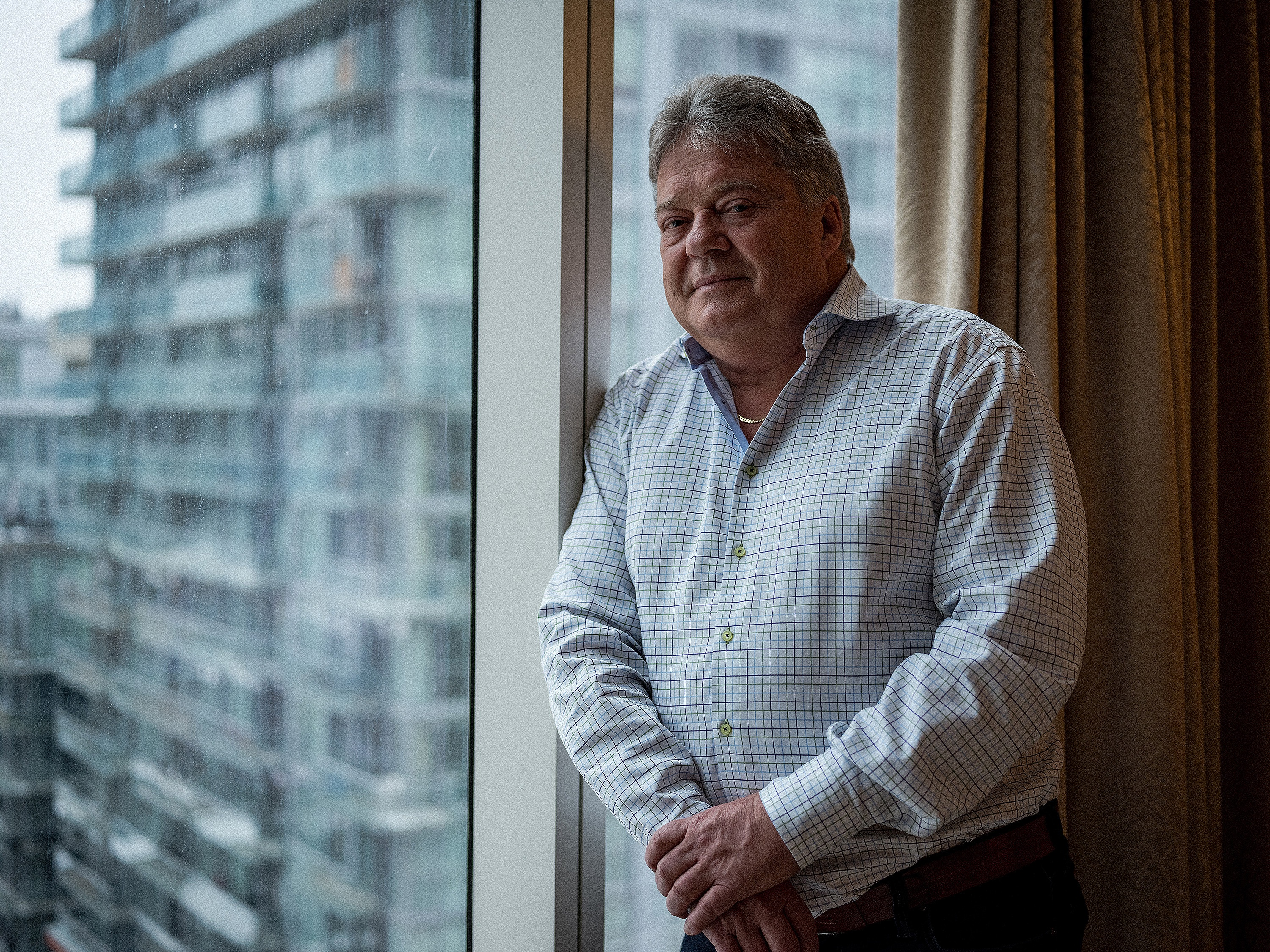 Vic Neufeld is the self-described 'money man' at the helm of Aphria, a Leamington, Ont.-based medical marijuana business. Neufeld, who grew up not far from Aphria's massive greenhouses, rose to prominence as the CEO of Canadian vitamin giant Jamieson. (Evan Mitsui/CBC)