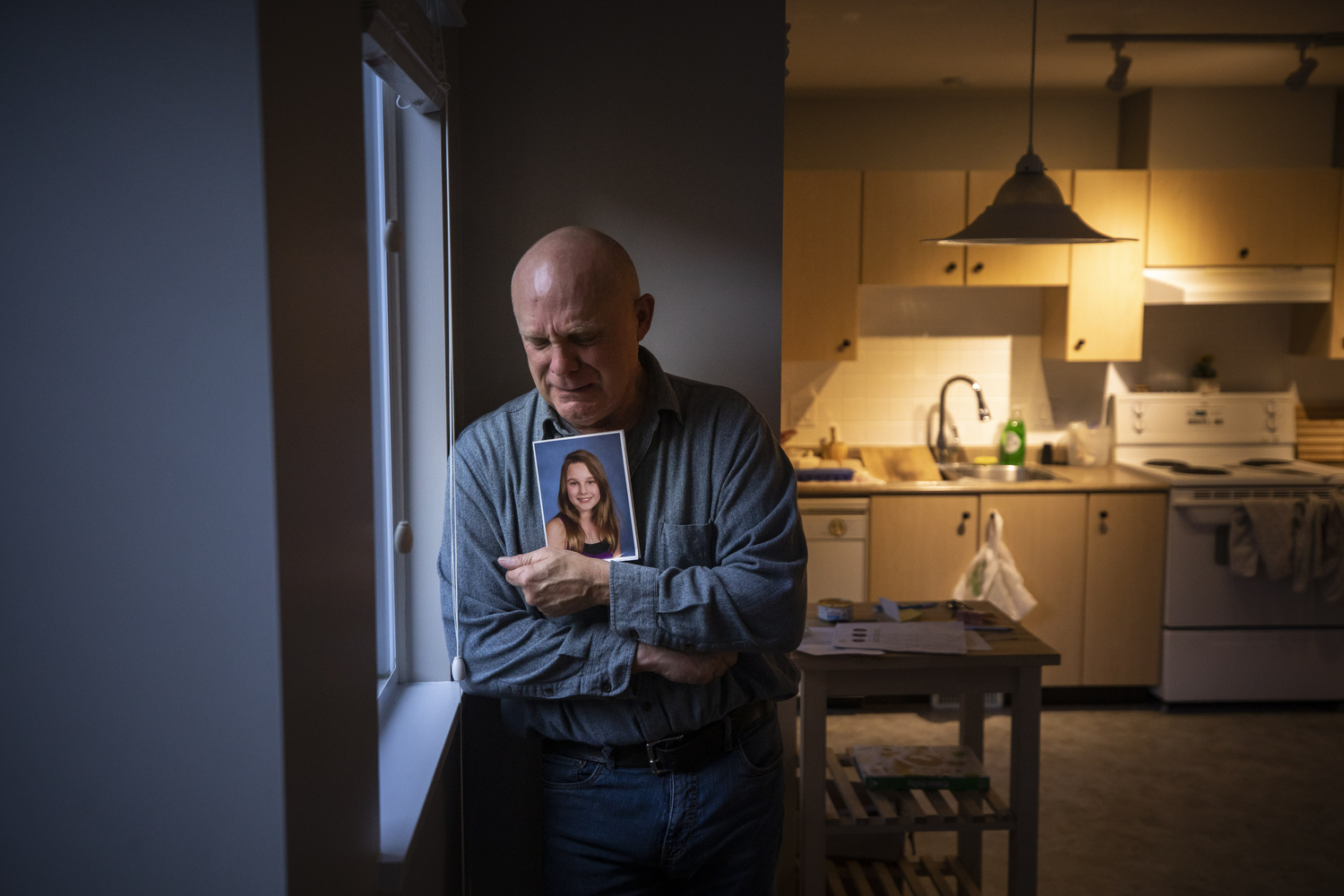 John Butler holds a photo of his daughter Olivia Dalton, who died of a fentanyl overdose in Langley, B.C., on Nov. 3, 2020. (Ben Nelms/CBC Vancouver)