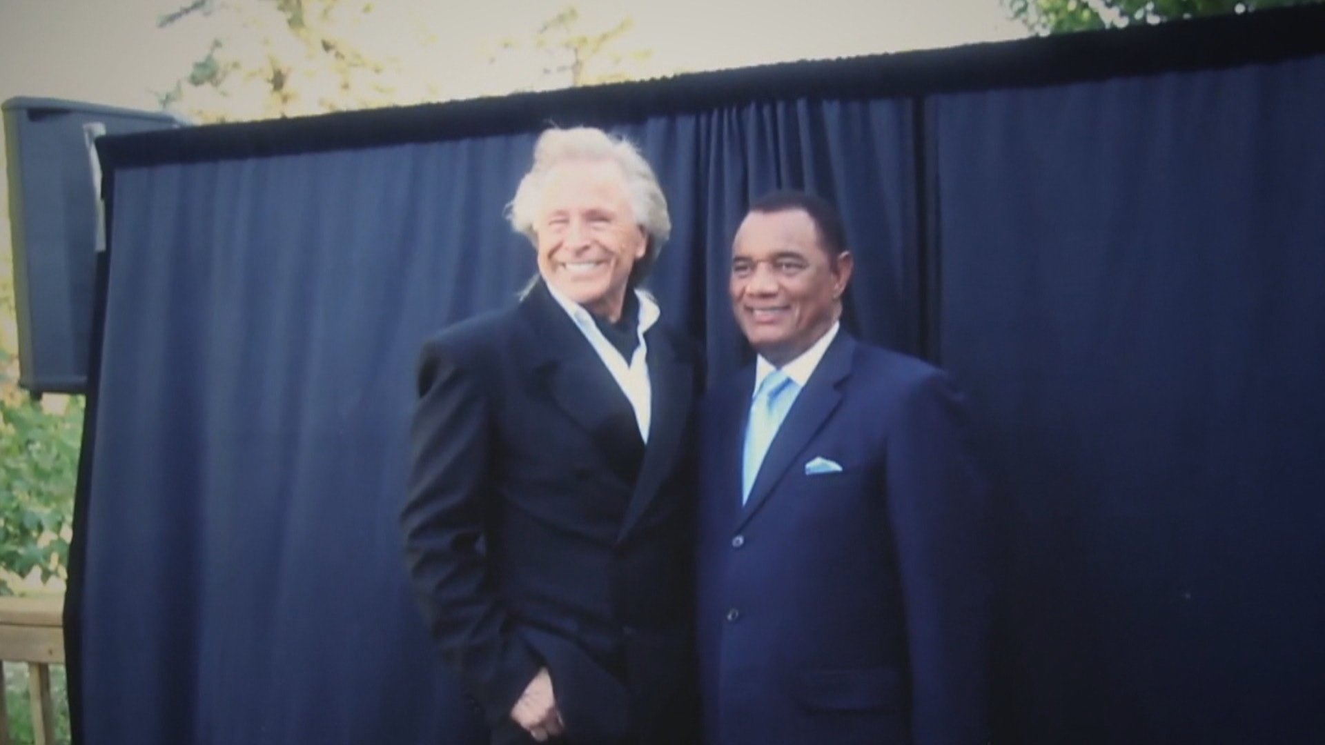 Christie poses for a photograph with Nygard at the wedding of Nygard's daughter in Winnipeg in July 2011. (Submitted by Stephen Feralio)
