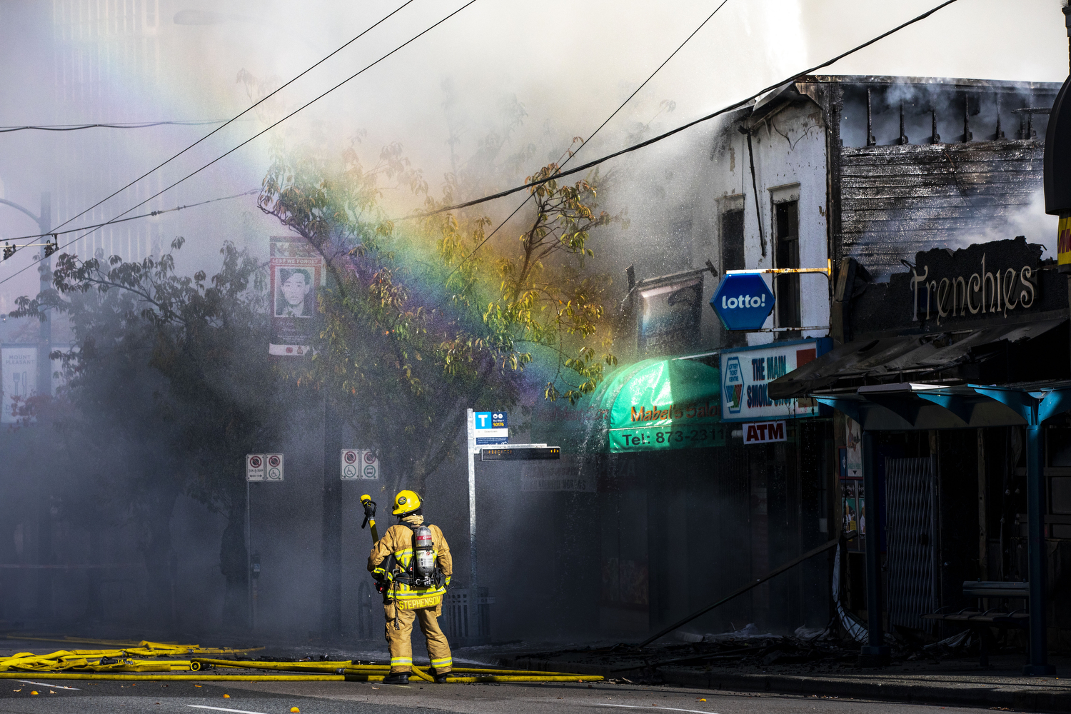 Vancouver fire crews work to contain a fire in the 2400 block of Main Street in Vancouver on Oct. 22, 2020. (Ben Nelms/CBC Vancouver)