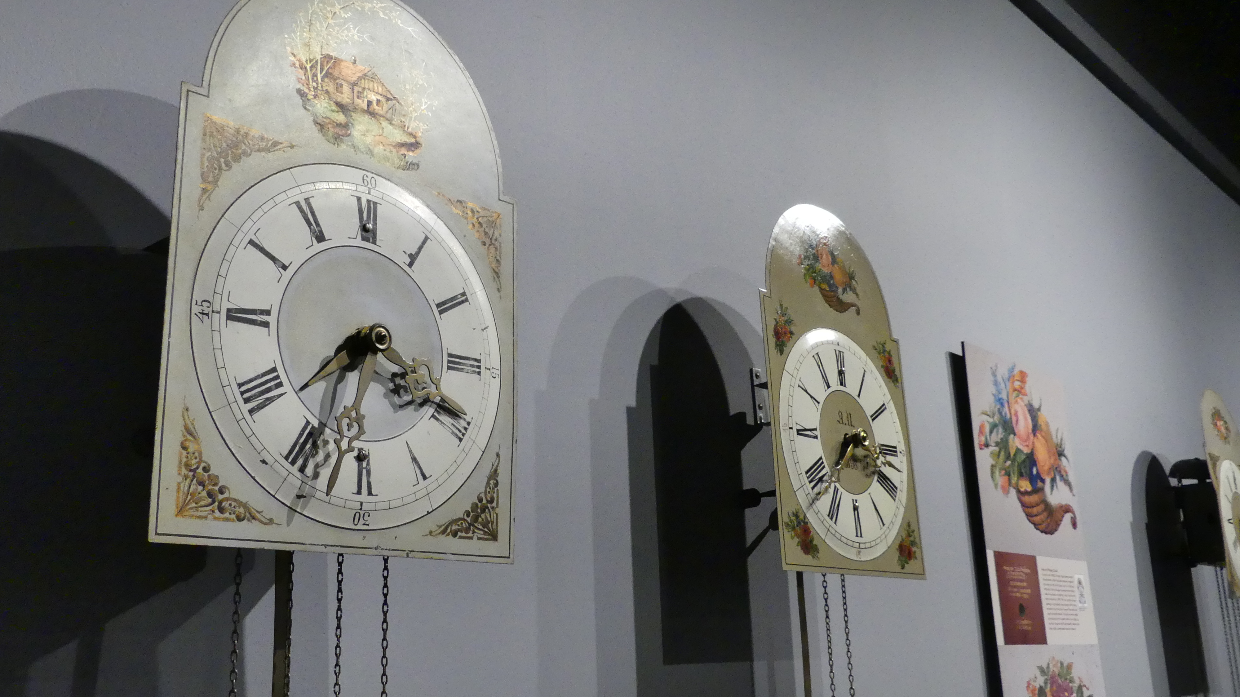 Clocks hang in an exhibit in Steinbach's Mennonite Heritage Village, silent for now. (Aidan Geary/CBC)