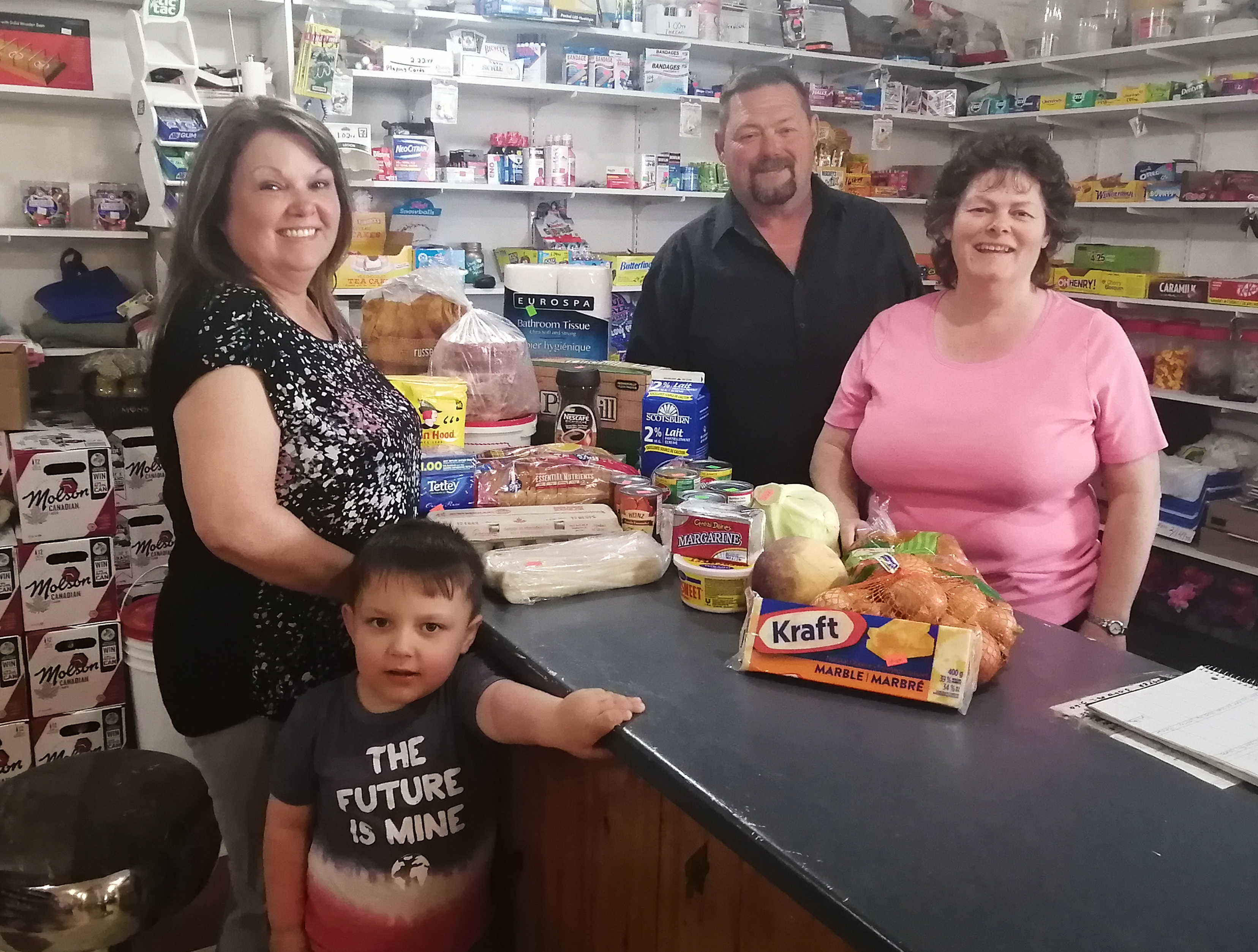 At Perrier's Convenience in Flat Bay, Bernadine Blanchard and Everette Perrier welcome customers ​Marjorie Bennett and Owen Hoskins. ​ (Submitted by Liz LaSaga)