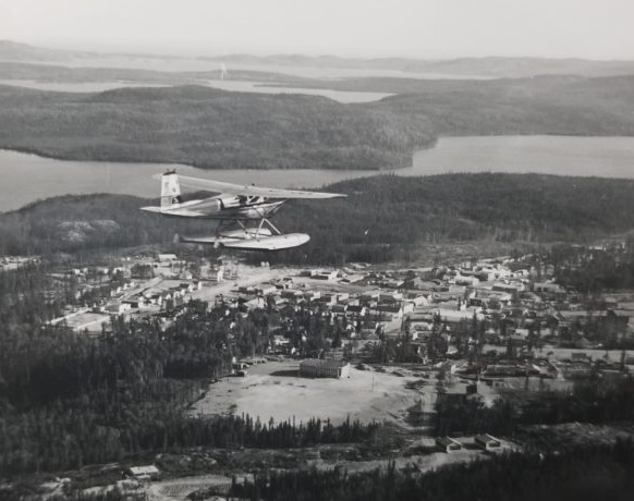 A Cessna 180 float plane over La Ronge, Sask., circa. 1957.This plane is the same make and model as the plane that crashed in 1959.