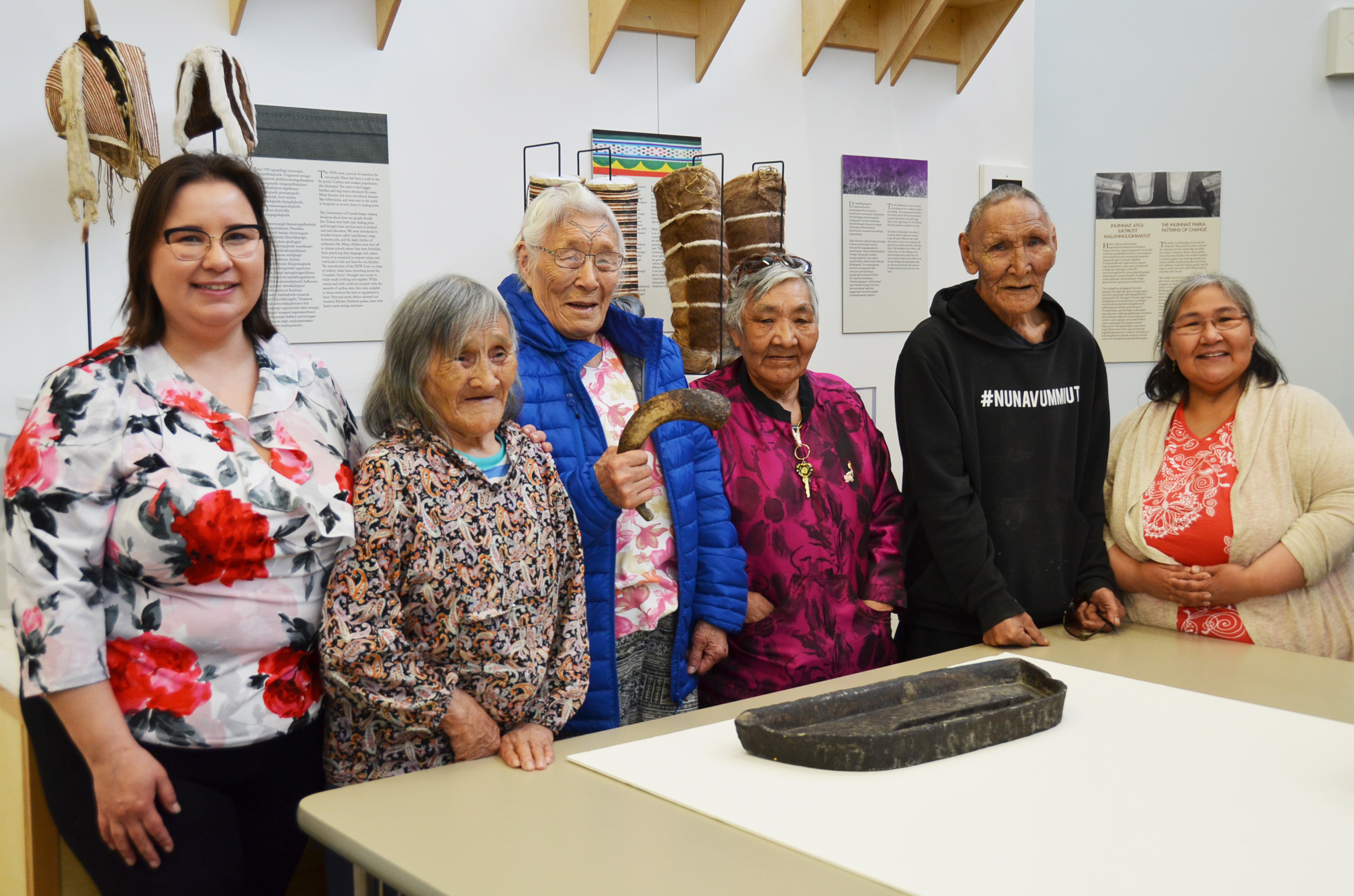 Pam Gross, left, poses for a photo with a group of elders at the May Hakongak Cultural Centre. Elders in residence at the centre sew traditional garments a few days a week, encouraging youth to drop by. (Pitquhirnikkut Ilihautiniq/Kitikmeot Heritage Society)