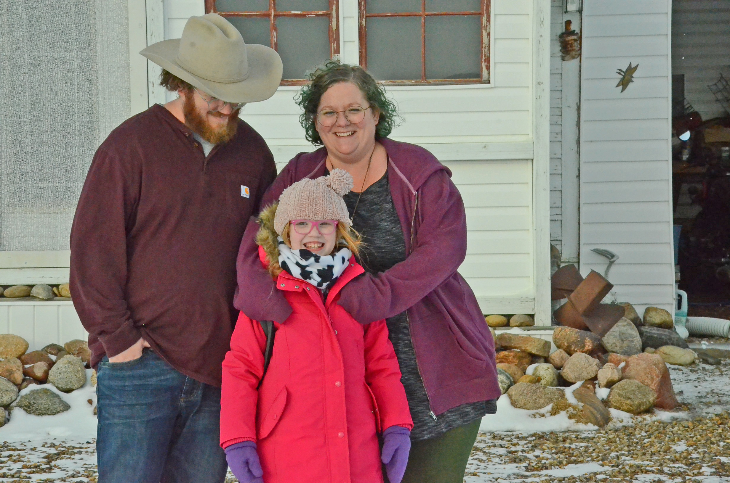 Brad and Colleen Proudlove, and their daughter, Neko, moved to a church near the U.S. border last year. (Bridget Yard/CBC)
