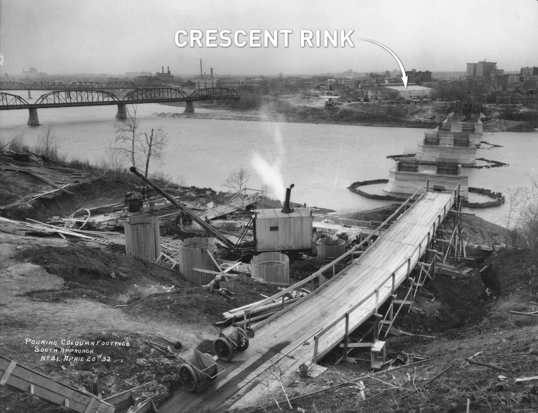 The Broadway Bridge, under construction in 1932. Crescent Rink is on the other side of the South Saskatchewan River. (Saskatoon Public Library Local History Room - Photo A-175)