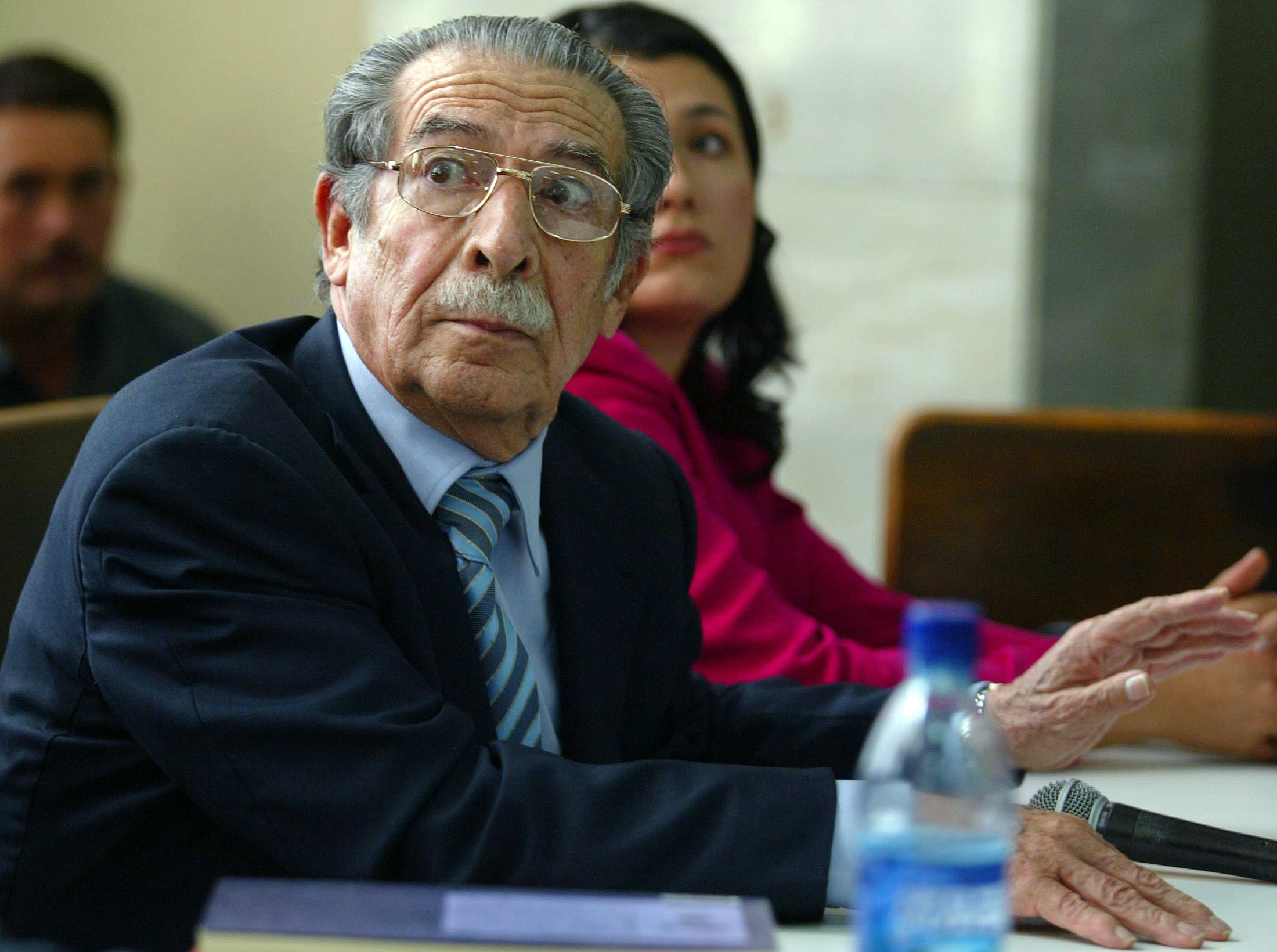 Former Guatemalan president Efrain Rios Montt listens during a court hearing in Guatemala City on Jan. 27, 2006. (Carlos Duarte/Reuters)