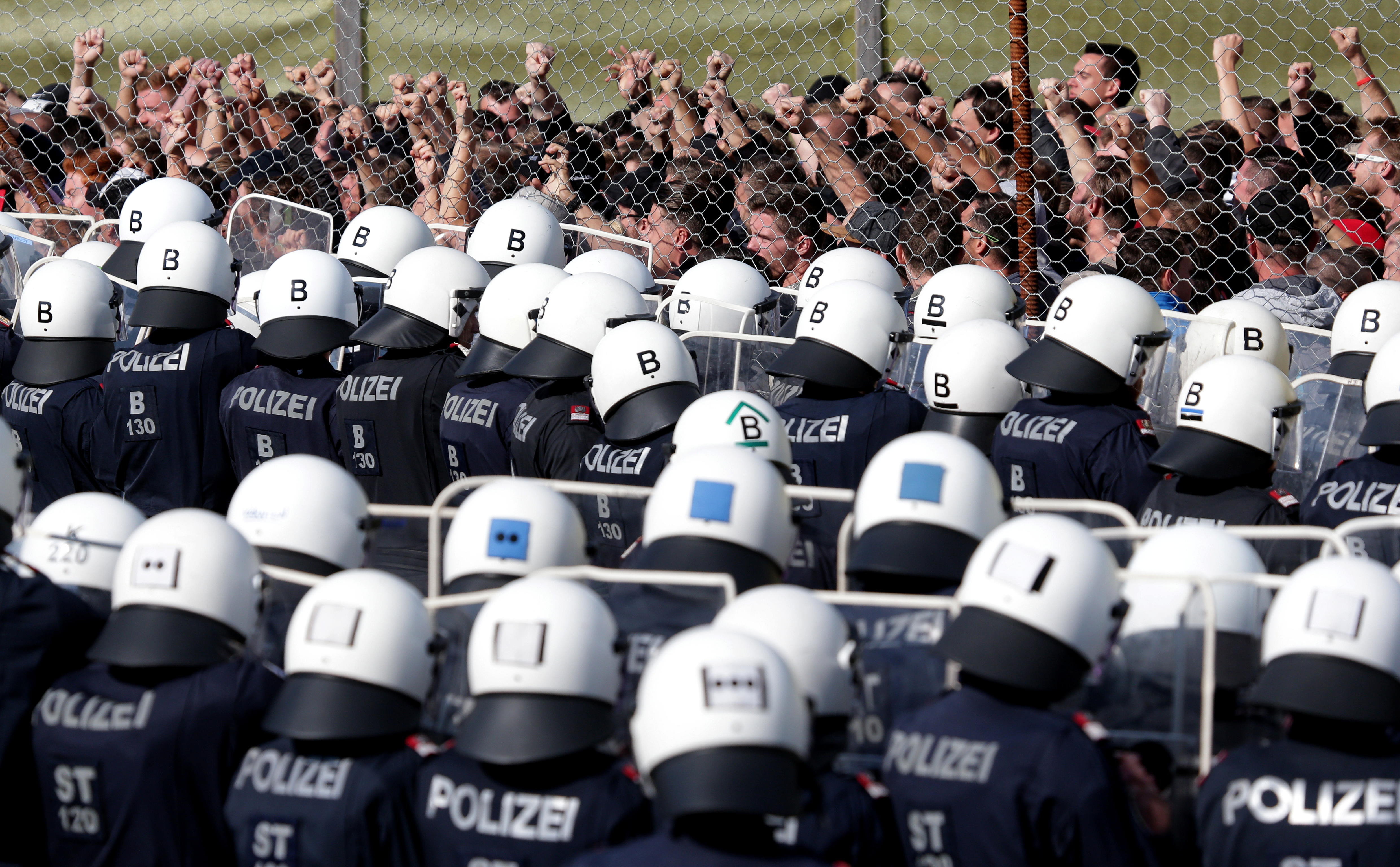 Police officers attend an exercise to prevent migrants from crossing the Austrian border from Slovenia, in Spielfeld, Austria, June 26, 2018. (Lisi Niesner/Reuters)