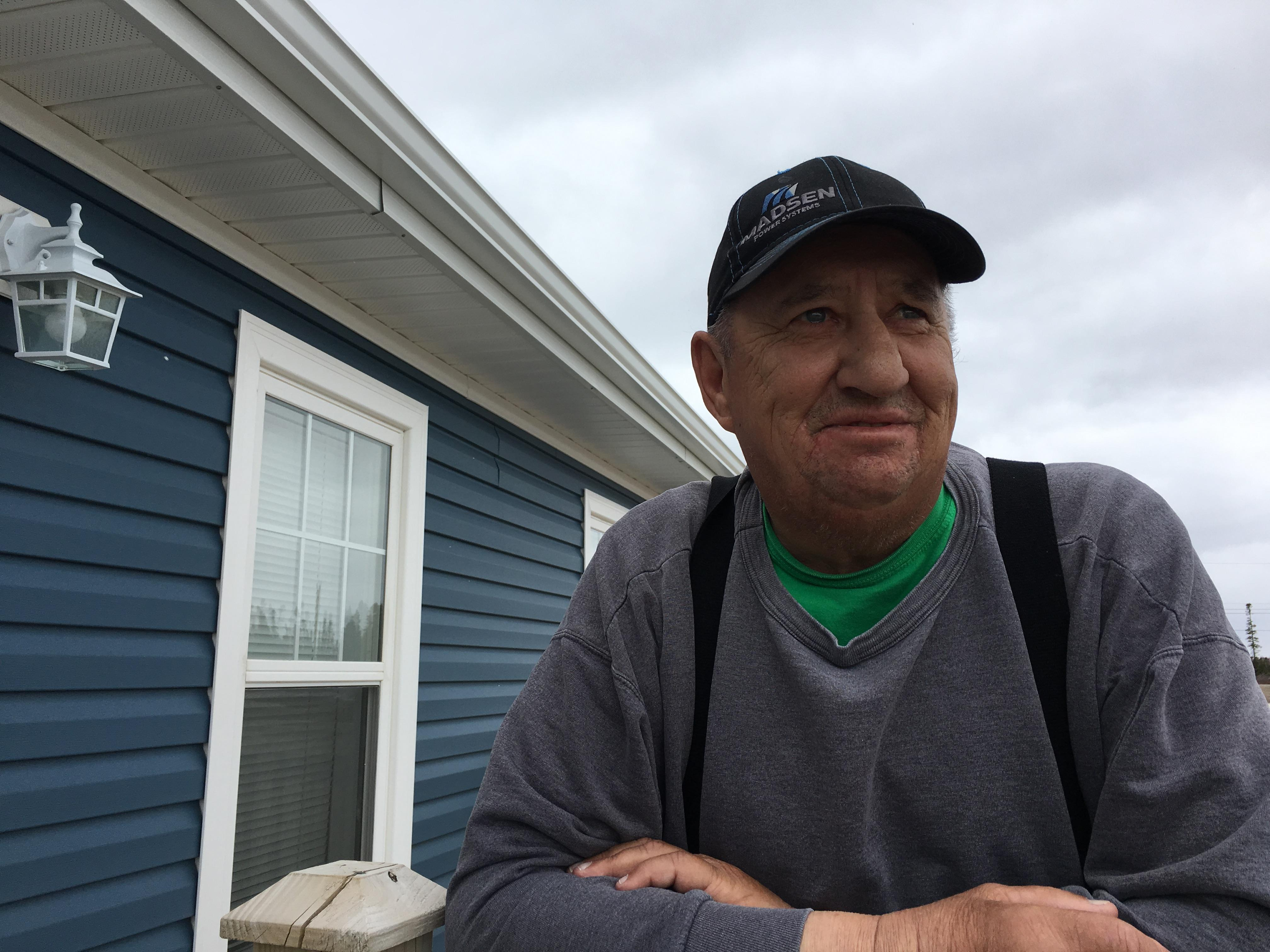 Ronnie Hopkins stands on the front step at his Brett Street apartment in Happy Valley-Goose Bay. It's a nice place, Hopkins says, but he is eager to get home to Mud Lake.  (Bailey White/CBC)