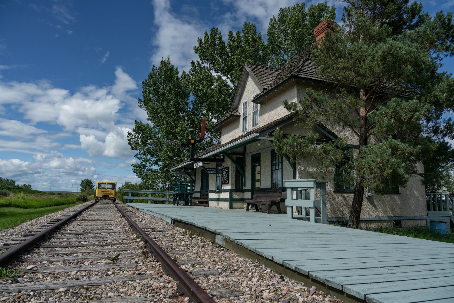 The main rail line was removed years ago but a short section of track remains outside the historic station in Rowley, Alta. (Vincent Bonnay/Radio-Canada)