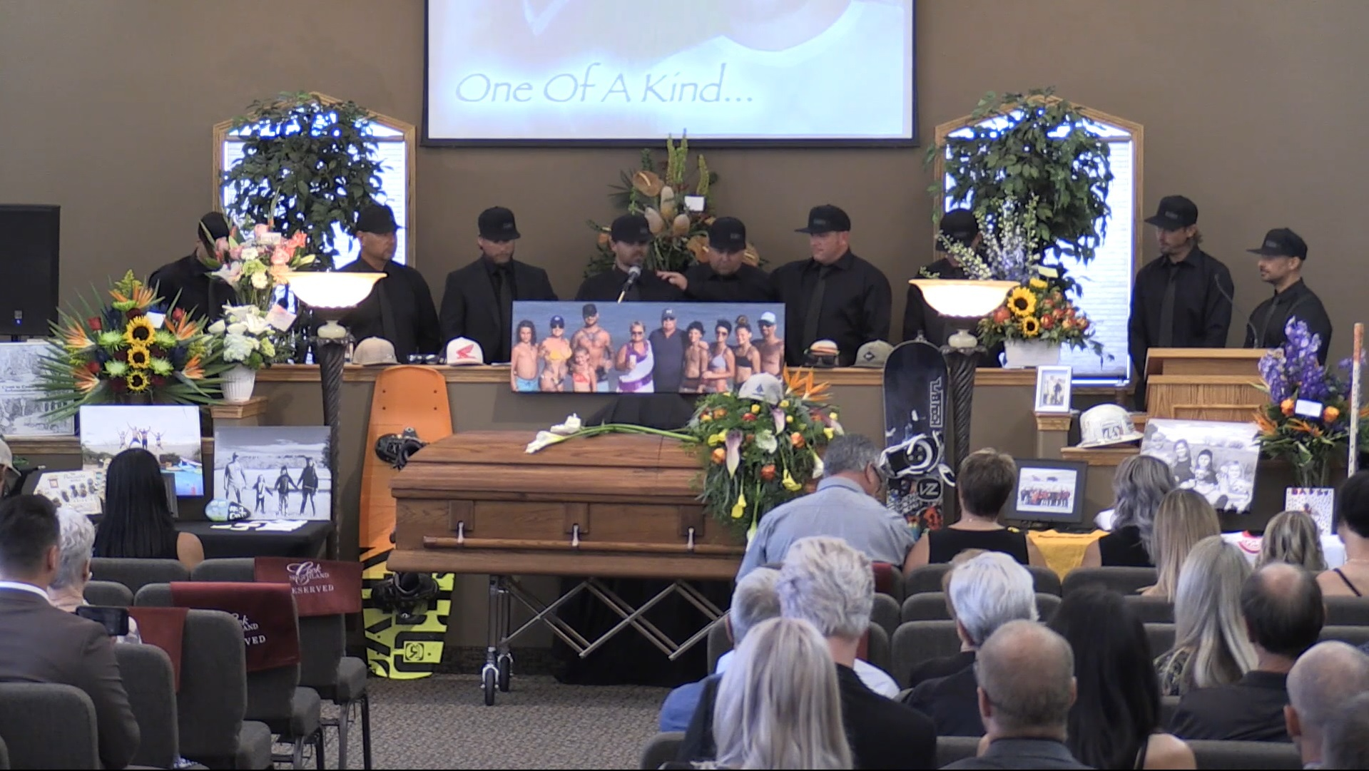 A group of male friends and family members gather side-by-side to talk about Ryan Pancoast at his funeral. (Screenshot of video by RJF Productions, submitted by Jordan Pancoast.)