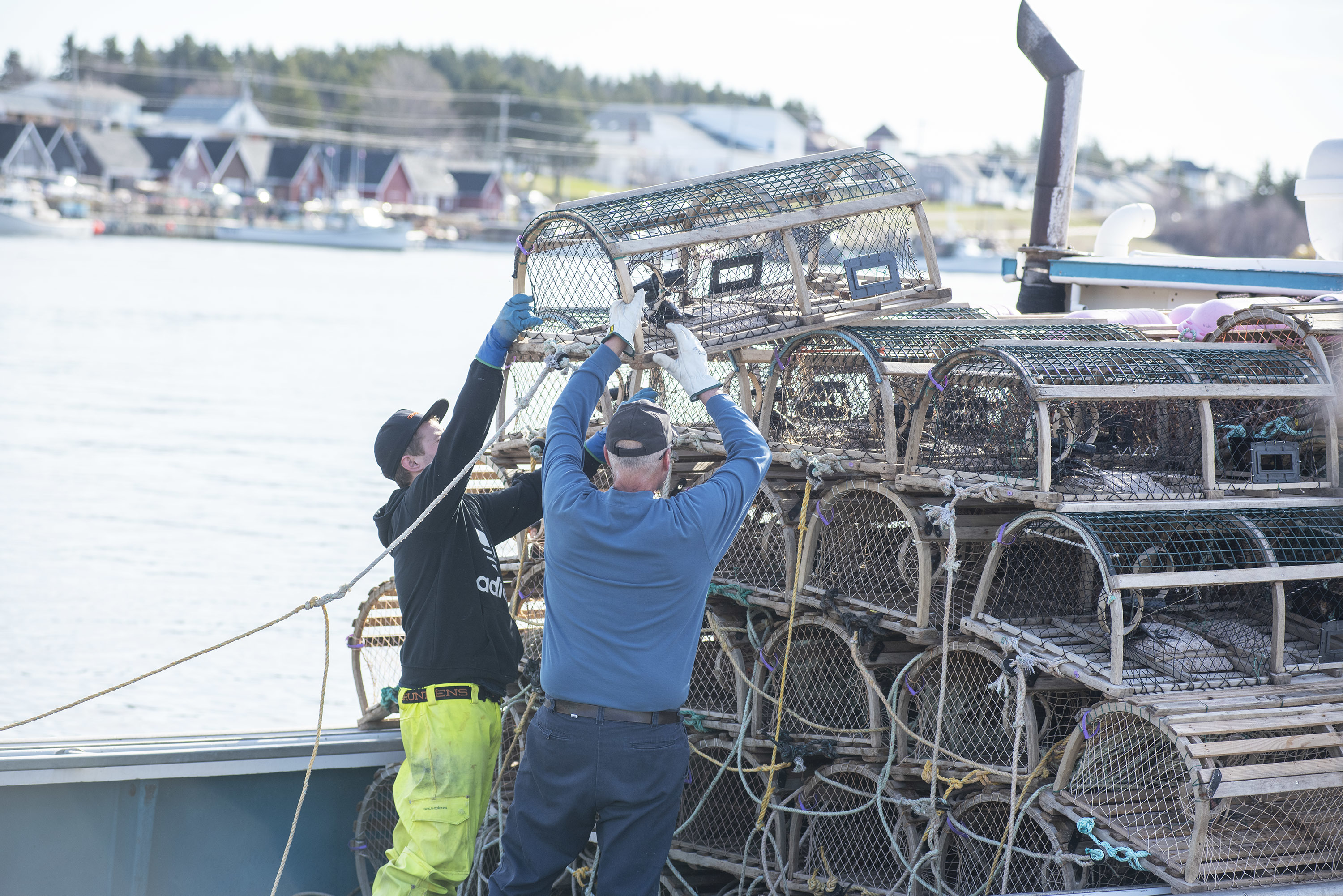 The second and last load of traps for the day is being loaded onto a boat. (Brian McInnis)