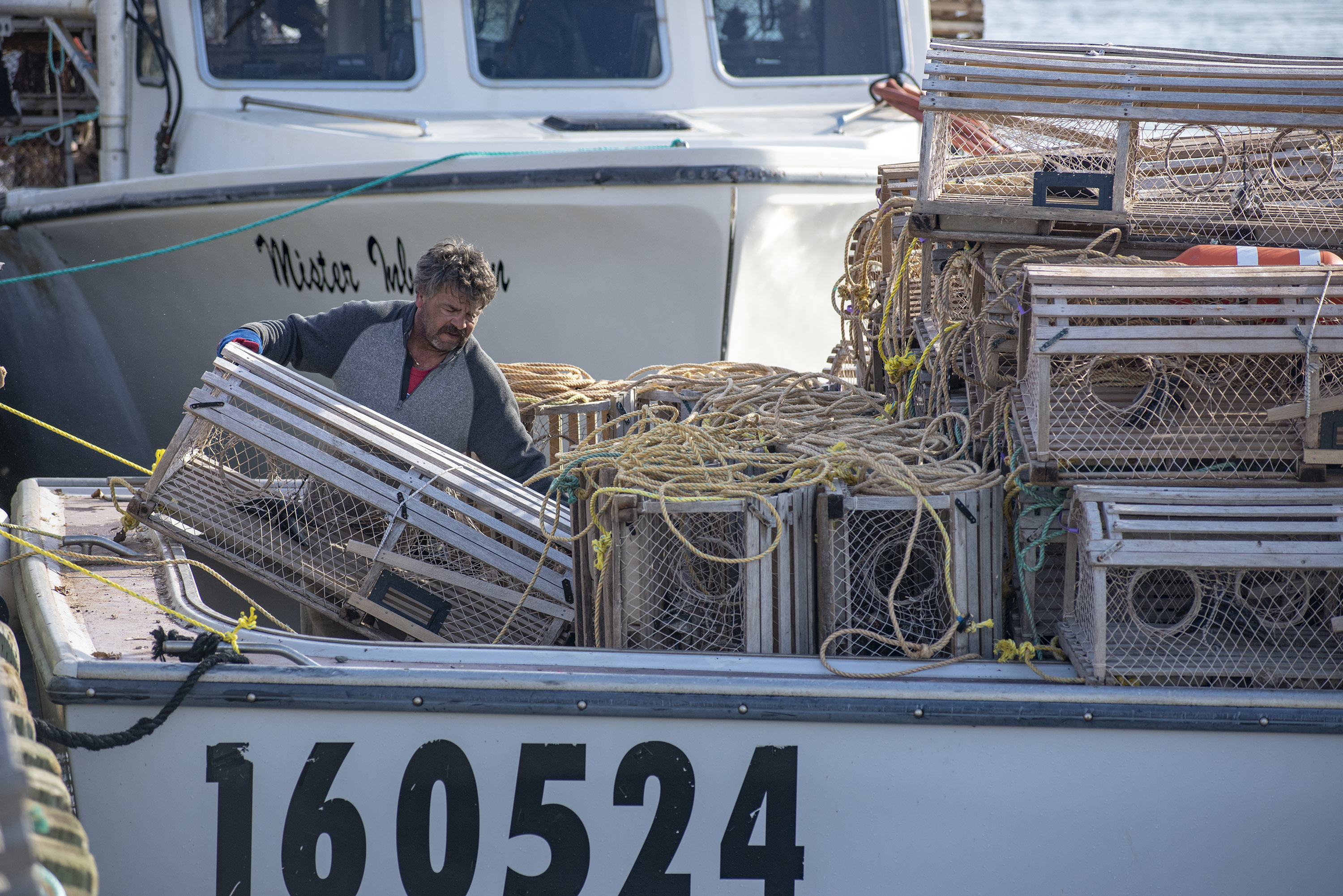 When all 150 or so traps are loaded onto a boat there is not much room left for the crew. (Brian McInnis)
