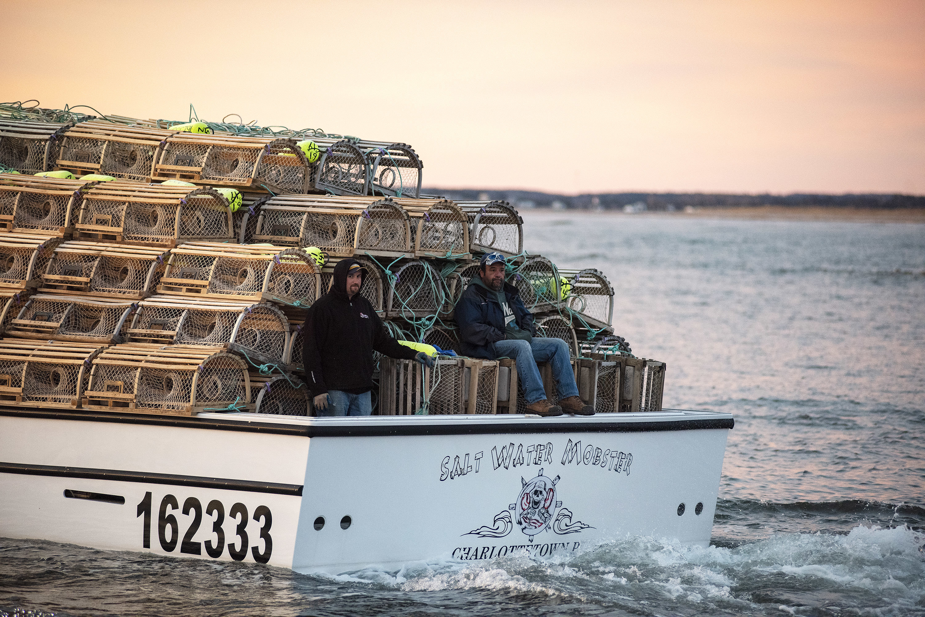 Crew members of Salt Water Mobster relax before the hard work begins as the boat heads out into the Gulf of St. Lawrence. (Brian McInnis)