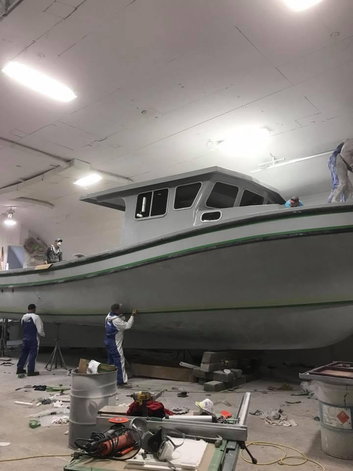 Staff at Samson Enterprises in Petit-de-Grat, N.S., work on a lobster boat in progress. (Submitted by Nova Scotia Boatbuilders Association)