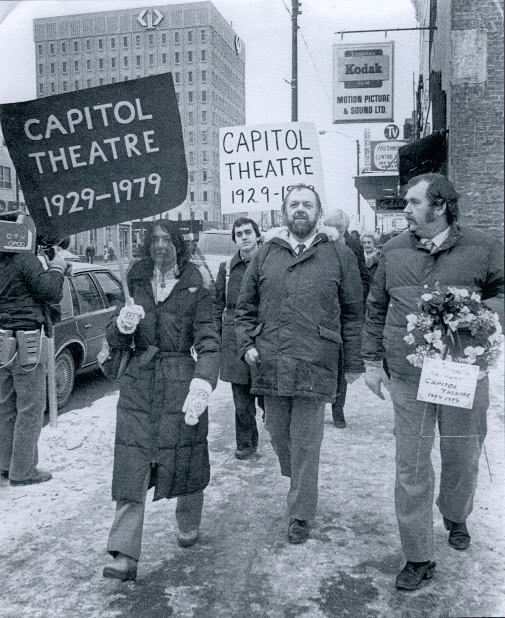 Black-veil-wearing Peggy Sarjeant, left, and her husband Bill Sarjeant, middle, host a public mourning of the Capitol two years after its demolition. Bill Sarjeant died in 2002. Peggy went on to lead Saskatoon's heritage community. (Saskatoon StarPhoenix)