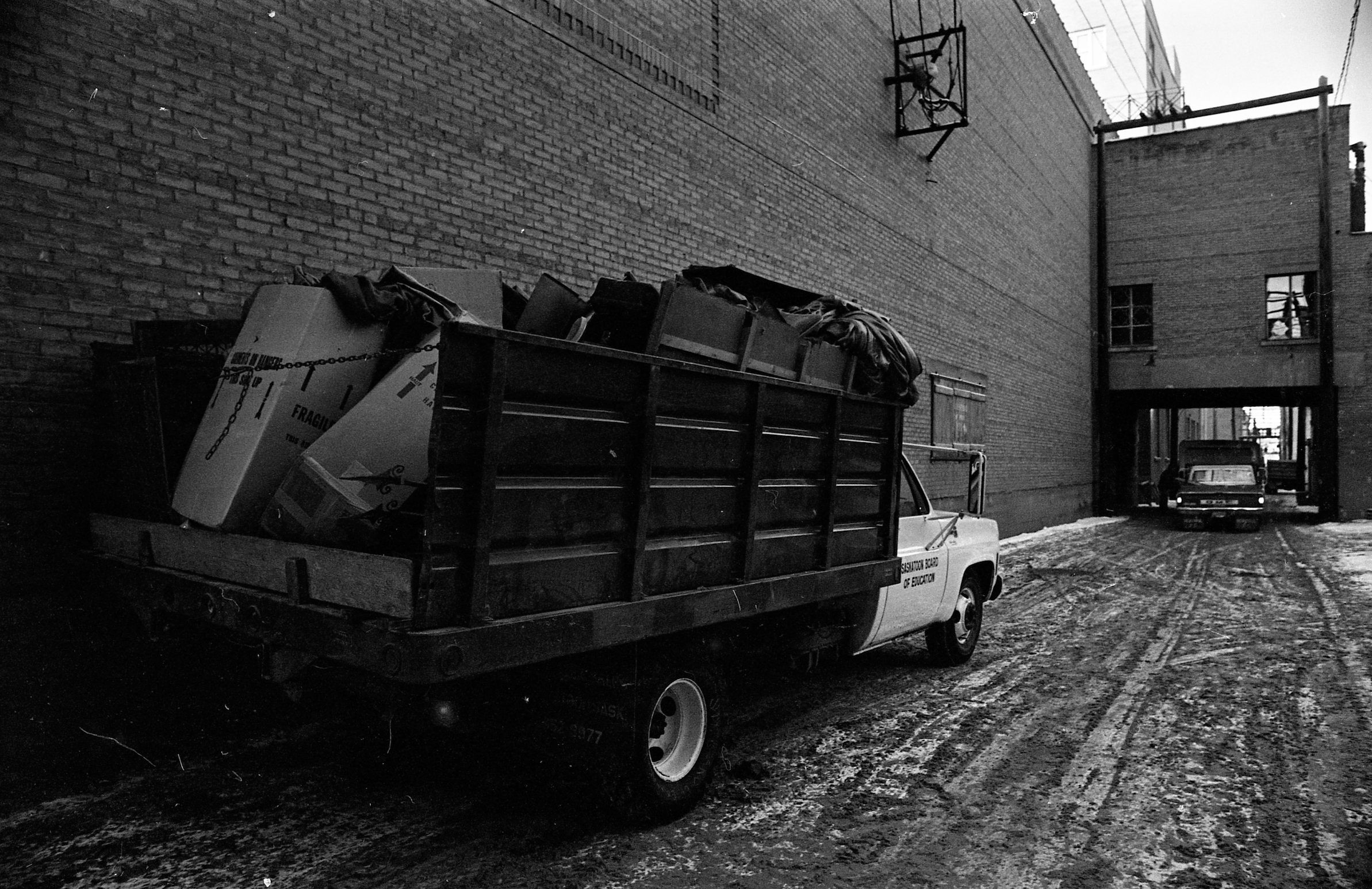 A Saskatoon Board of Education truck makes off with material from the Capitol during the demolition. (Saskatchewan Archives; item S-SP-A12333-13)