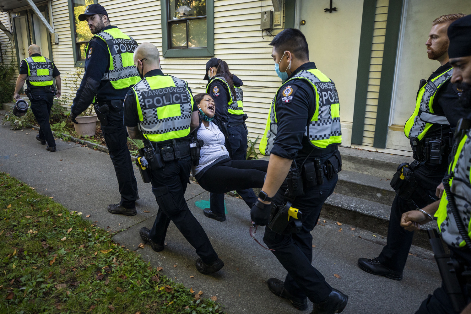 Activist Chrissy Brett is arrested during a housing-for-all protest near the tent emcampment she oversees in Strathcona Park in Vancouver on Sept. 28, 2020.  (Ben Nelms/CBC Vancouver)