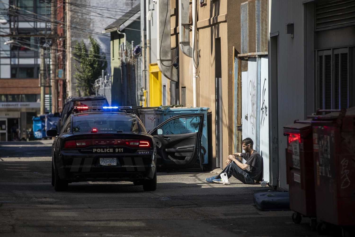 A man is detained by the Vancouver Police in the Downtown Eastside in Vancouver, British Columbia on Friday, September 6, 2019. (Ben Nelms/CBC)