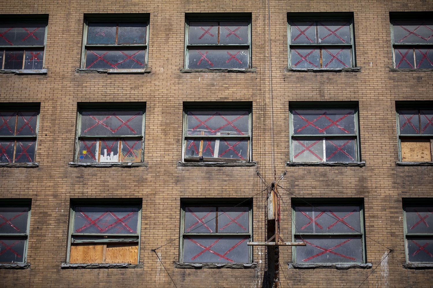 The windows of the Balmoral Hotel on Hastings Street in the Downtown Eastside in Vancouver, British Columbia. (Ben Nelms/CBC)