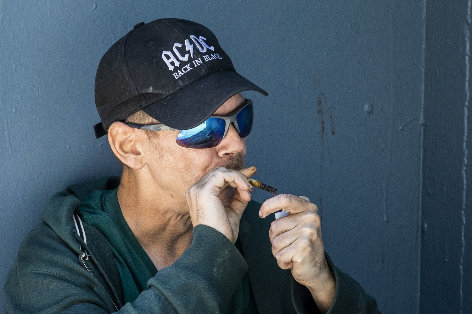 A man smokes drugs along Hastings Street in Vancouver, British Columbia on Friday, September 6, 2019. (Ben Nelms/CBC)