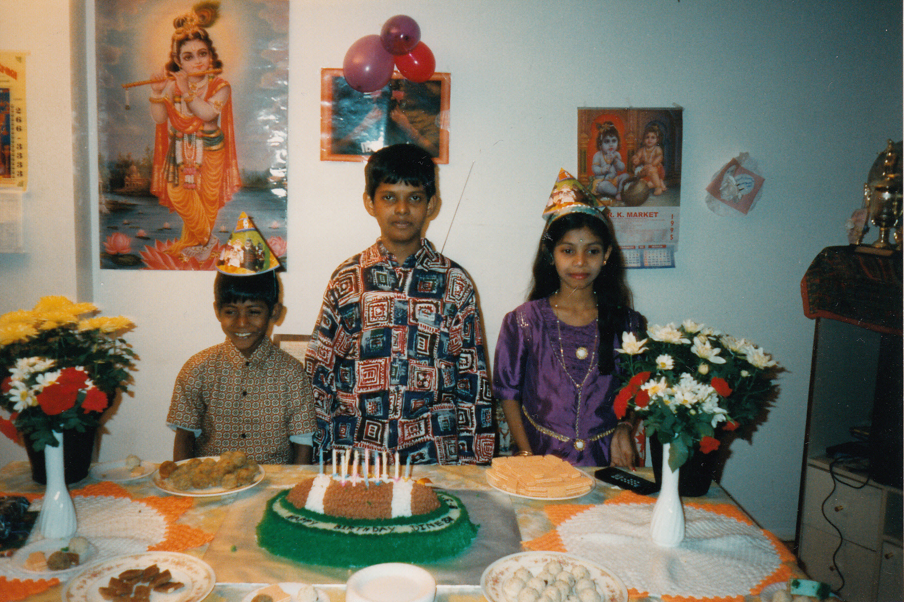 Sharmini is shown with her brothers, Kathees, right, and Dinesh, centre, during a birthday party.