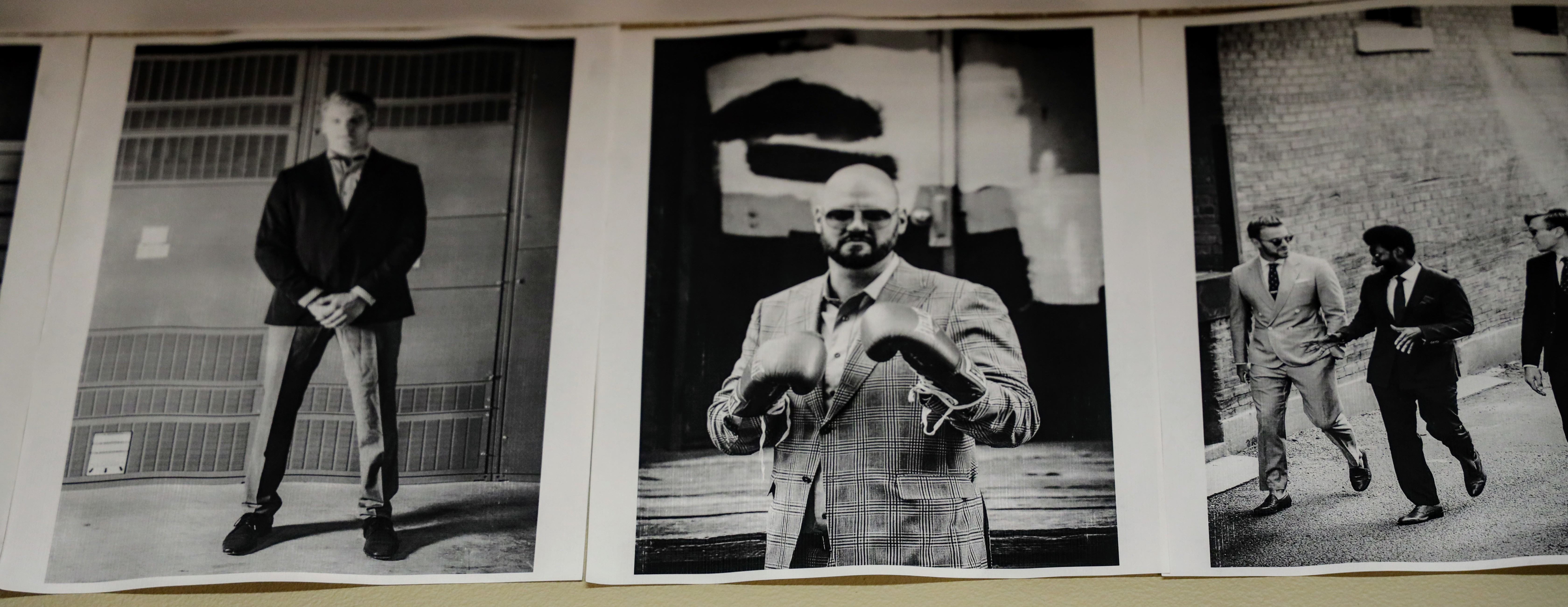 Black and white photos of some of his high-profile customers wearing his suits line the walls of Suits by Curtis Eliot.