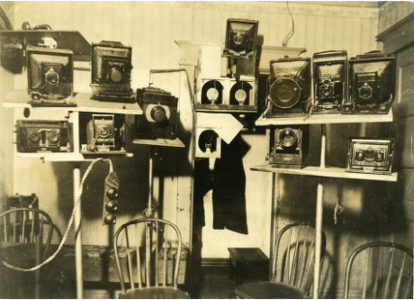 A battery of cameras covers one wall of the seance room in T.G. Hamilton's home.