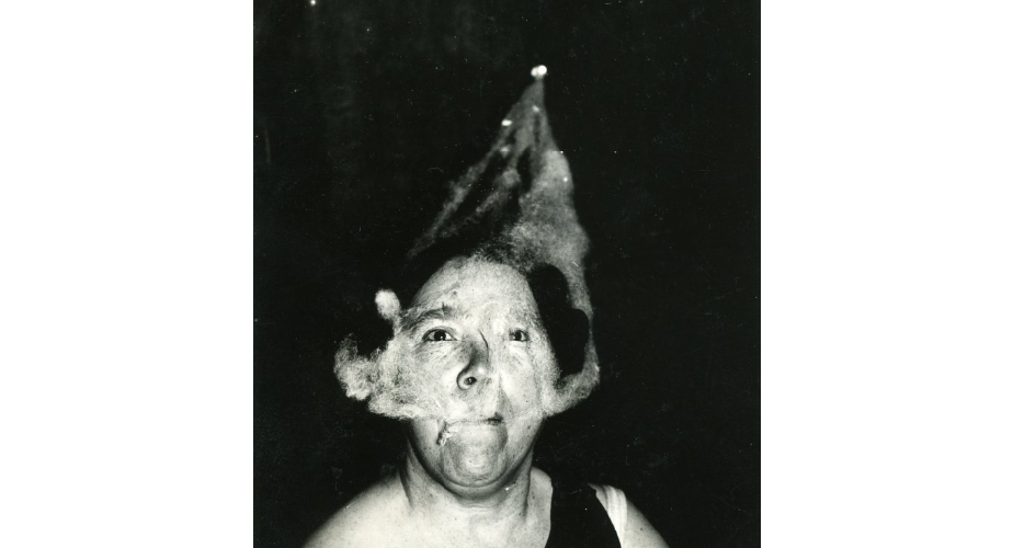 Ectoplasm forms on the face of medium Mary Marshall during a seance at T.G. Hamilton's home.