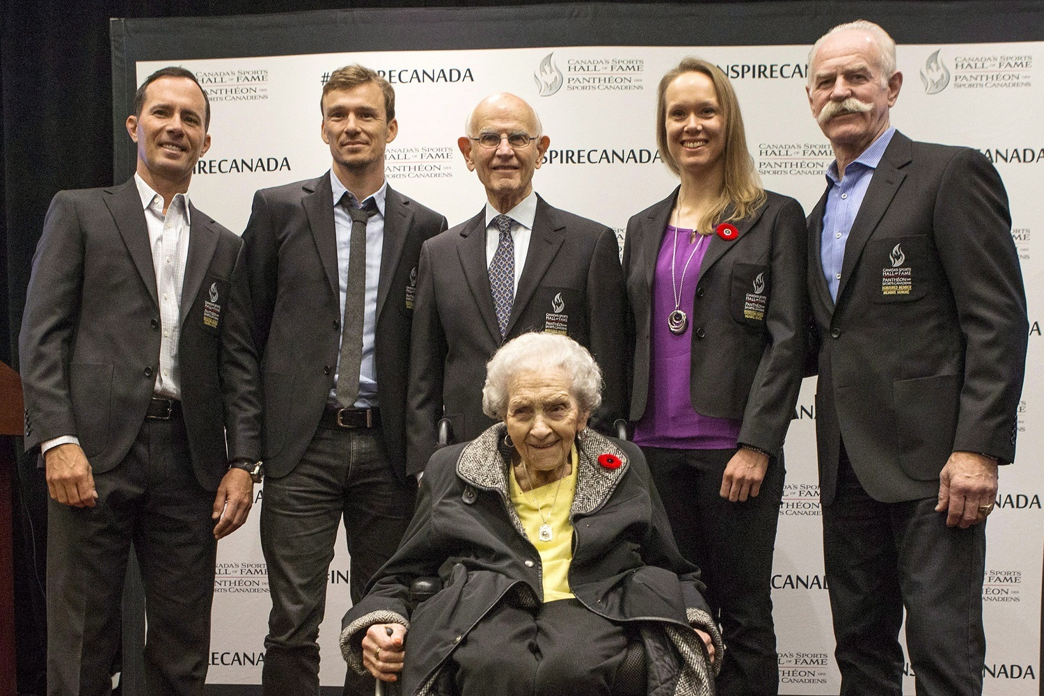 Dr. Charles Tator, centre top, at the announcement regarding his induction into the Canadian Sports Hall of Fame in Toronto, on Thursday, November 9, 2017. Dr. Tator was a 2016 Berlin consensus statement author, but is critical of its section on CTE. He is next to, from left to right, Mike Weir, Simon Whitfield, Tator, Cindy Klassen, Lanny McDonald and Kay MacBeth, sitting. (Chris Young/Canadian Press)