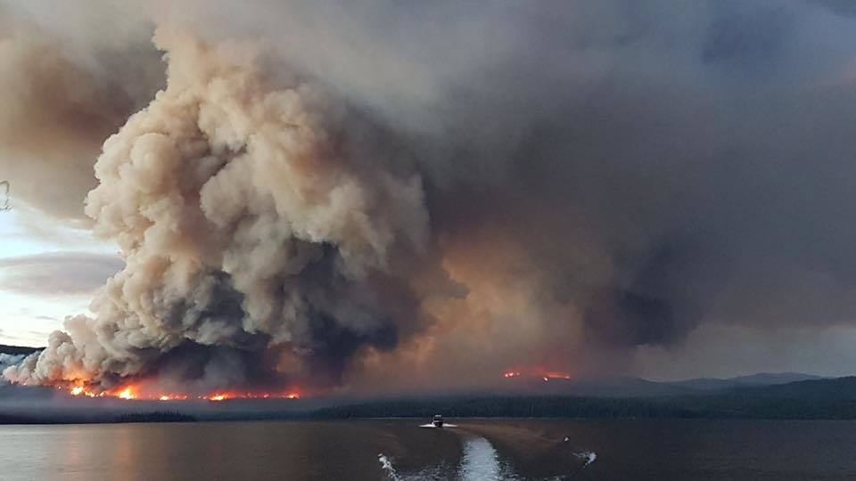 A wildfire burns across the lake from the Pondosy Bay Wilderness Resort near Tweedsmuir in the summer of 2018. (Pondosy Bay Wilderness Resort)