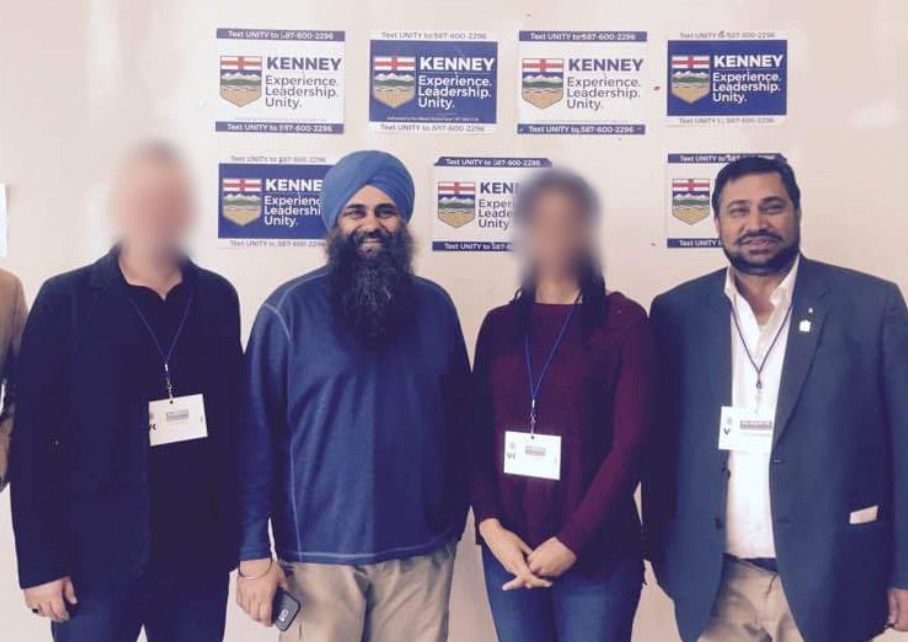 Federal Conservative candidate and former cabinet minister Tim Uppal, second from left, and former PC MLA Peter Sandhu, right, inside the kiosk on Ellerslie Road. CBC News has blurred the faces of others not mentioned in this story. (Facebook)