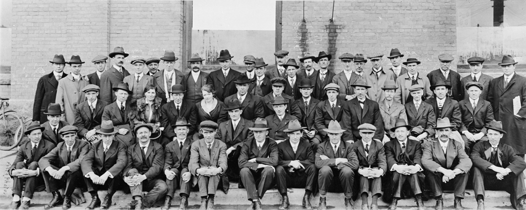 The Winnipeg General Strike Committee poses in front of a brick building in 1919. The individuals are not identified, but Helen Armstrong is in the middle row, third from the left. (Archives of Manitoba)