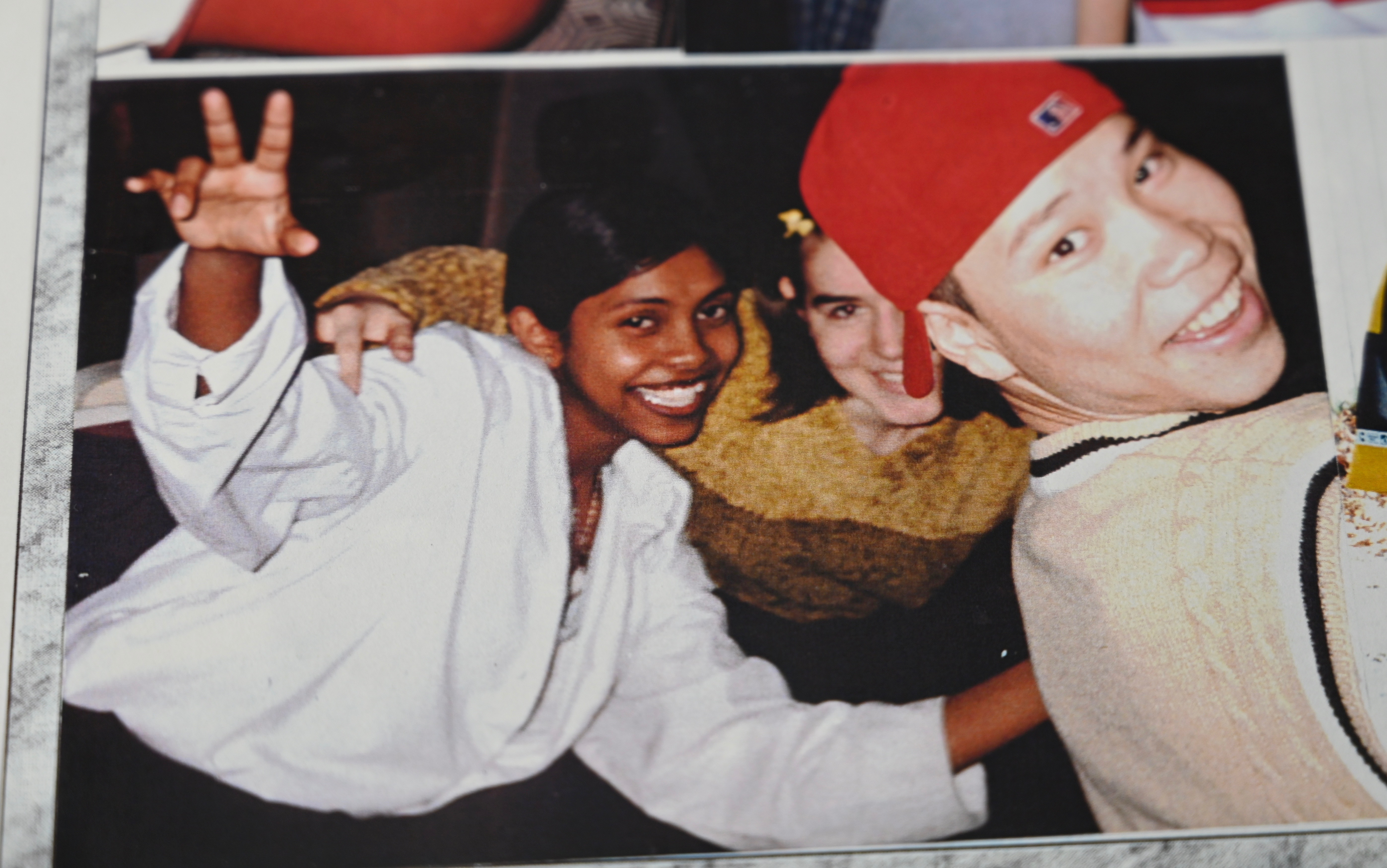 Sharmini, left, is shown with two friends in an image from her Grade 9 yearbook. (CBC)