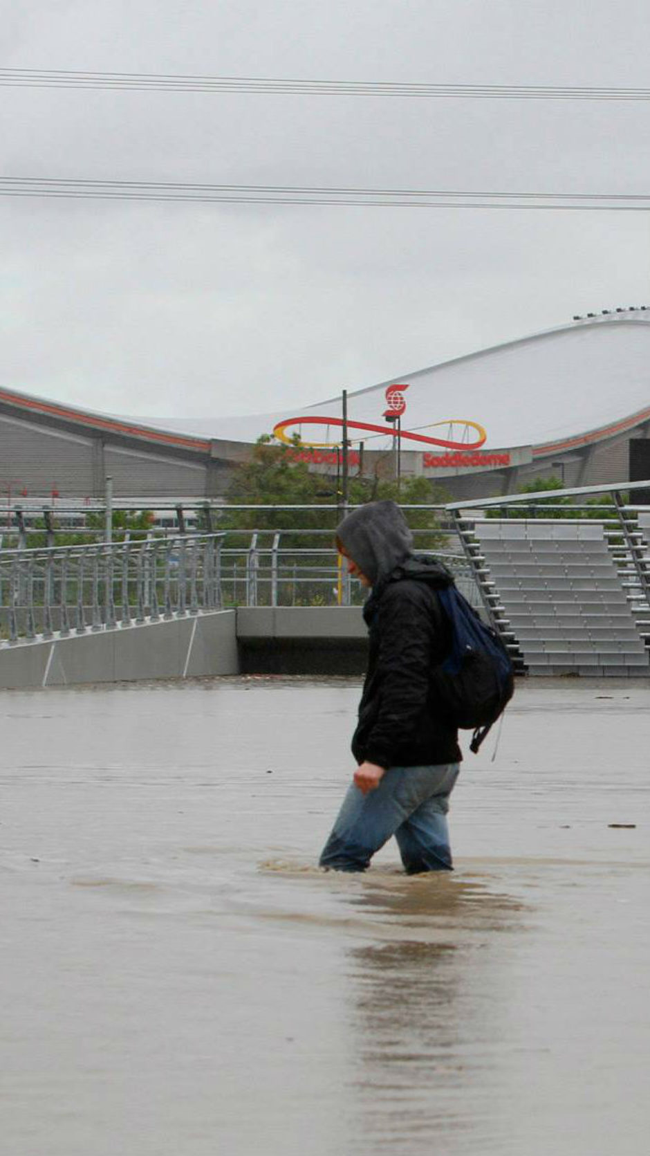 A man walks, thigh-deep in water, along Ninth Avenue in downtown Calgary during the 2013 flood.