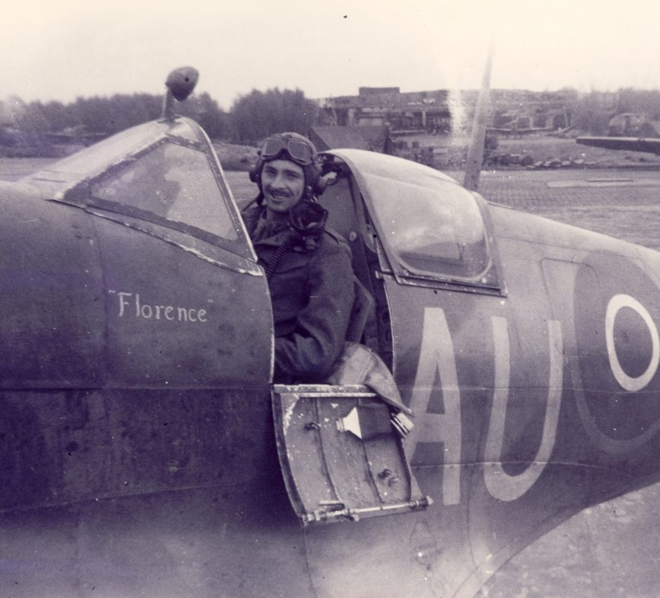 Royal Canadian Air Force pilot Ed Mann is shown in the cockpit of his Spitfire, which was named Florence after his wife.