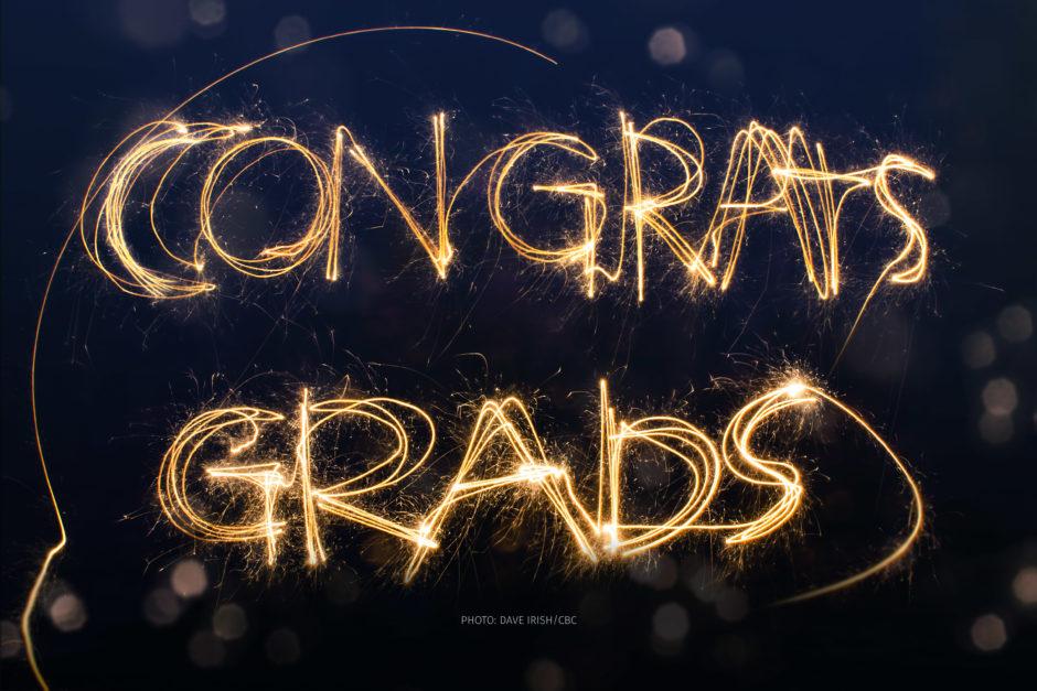 "A sparkler spells out, ""Congrats, grads,"" against a dark sky."