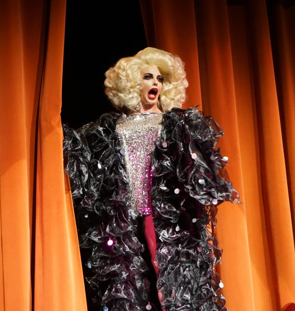 Drag queen Alyssa Edwards opens the curtain at a show at the Spatz Theatre in Halifax.