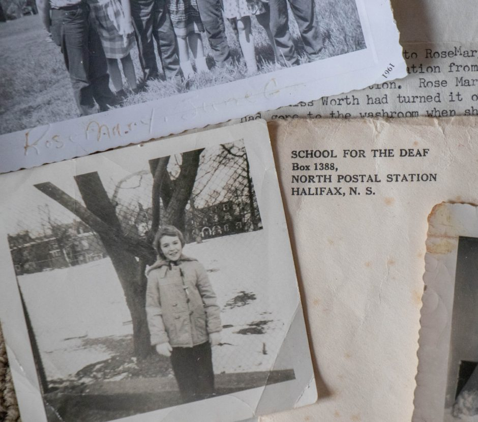 Two old photos of a little girl are shown with an envelop with the Halifax address of the School for the Deaf.