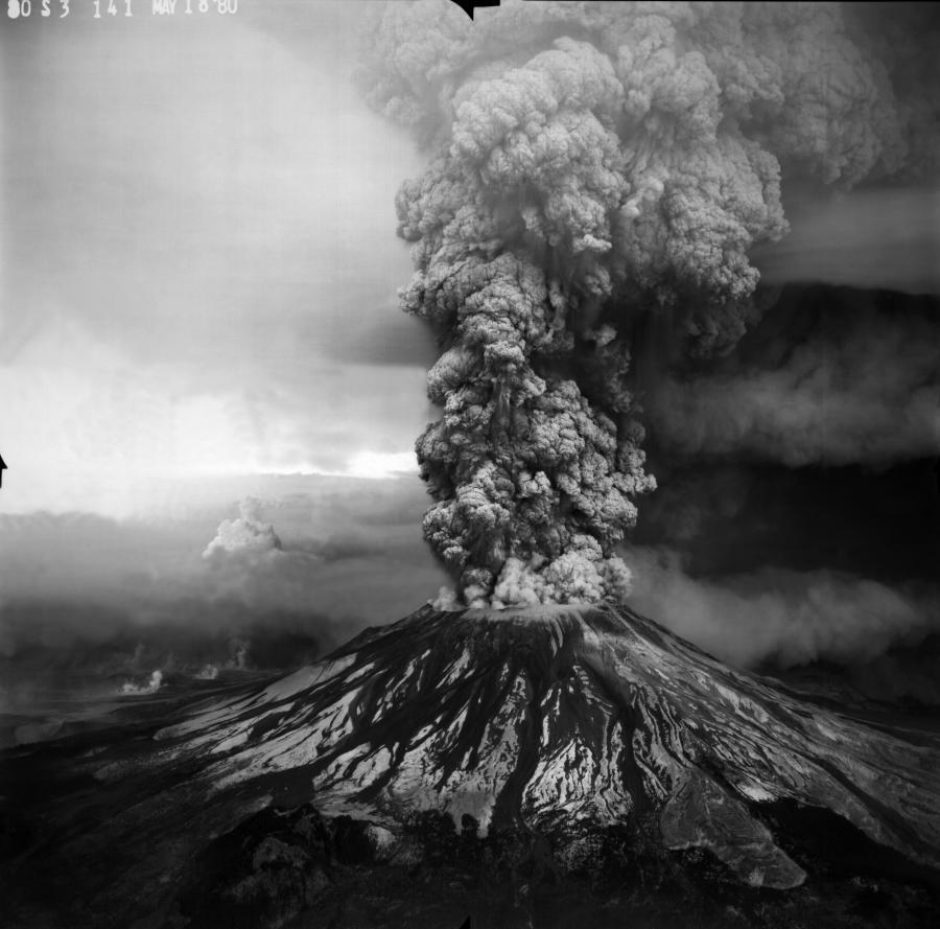 An aerial view of the grey column of ash billowing out of Mount St. Helens during the eruption on May 18, 1980.