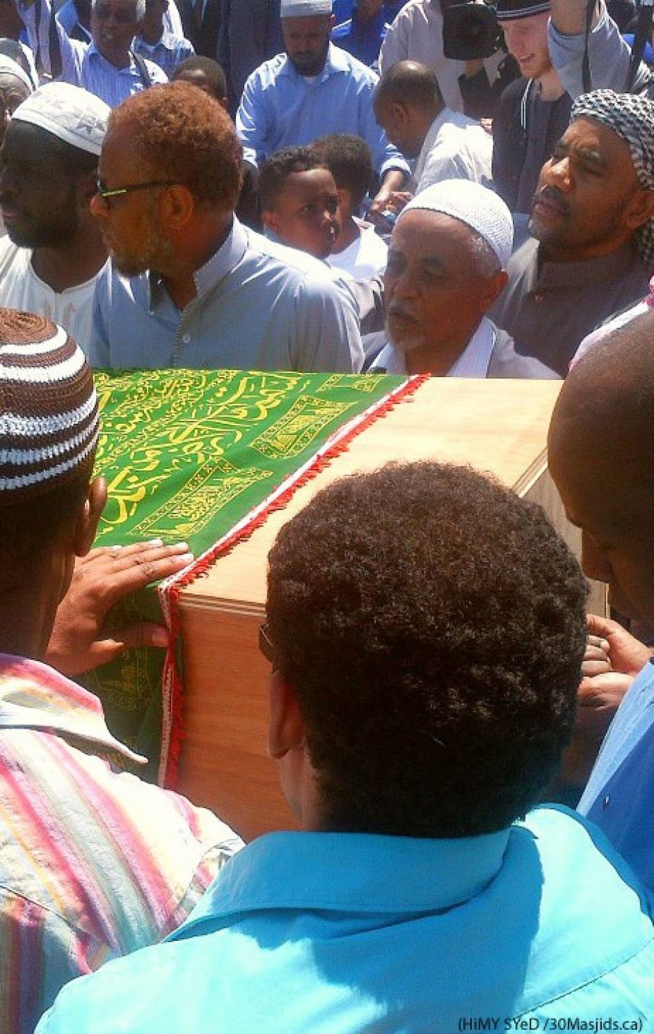 Mourners carry the coffin of a young Somali man killed in Toronto's west end (HiMY SYeD)