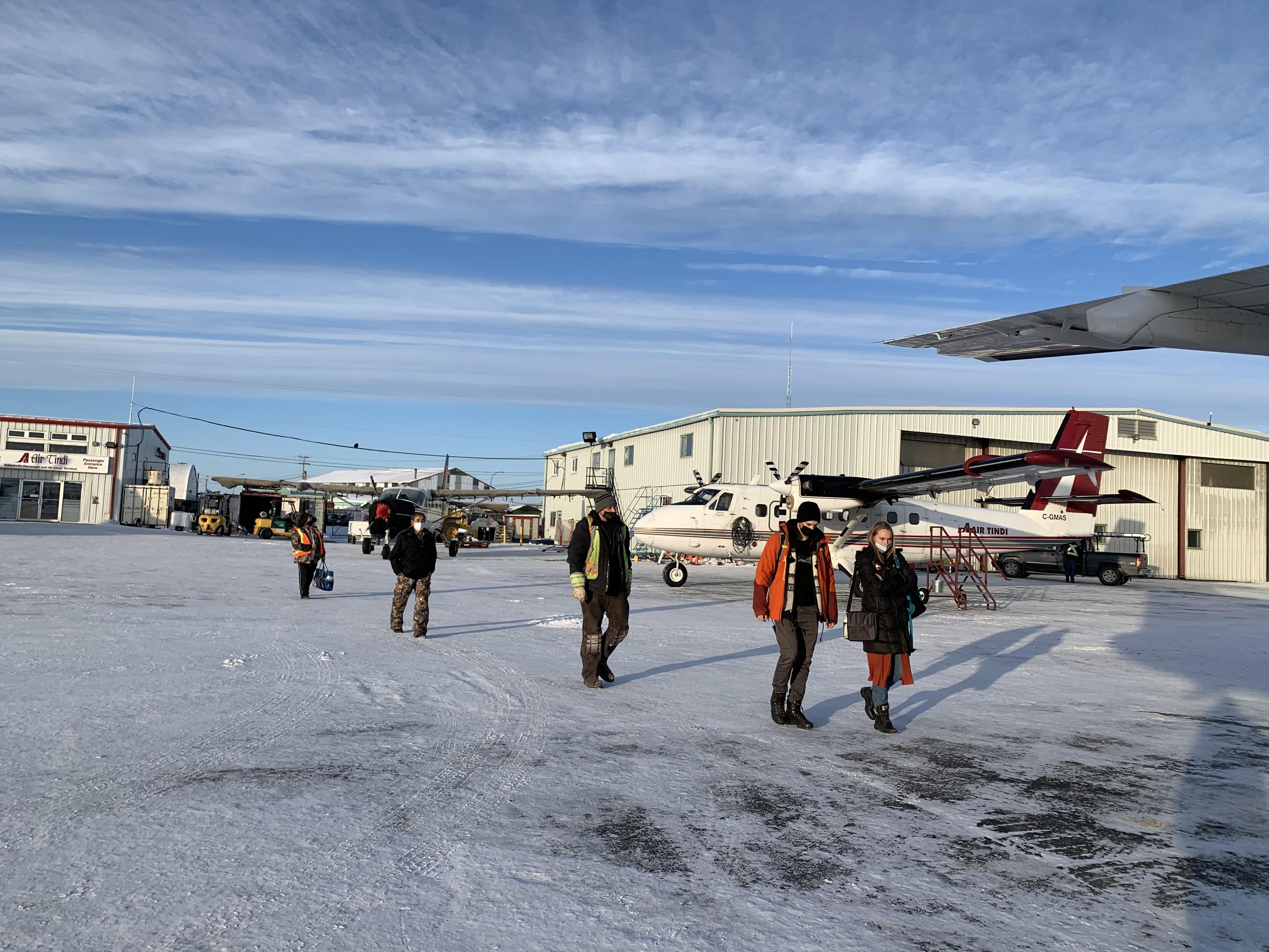 Passengers board a flight to Wekweètì and Gameti. (Sidney Cohen/CBC)