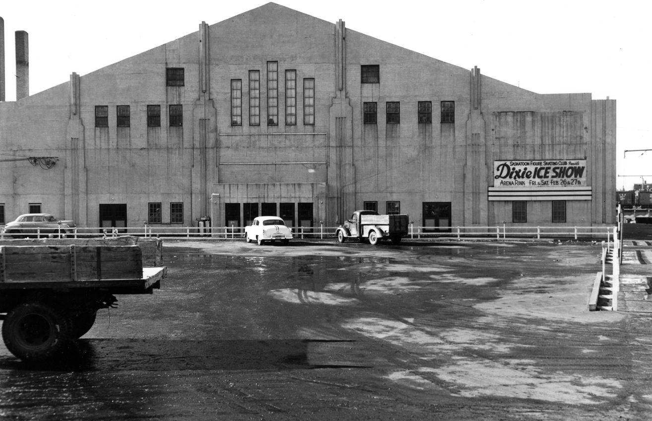 """A billboard at Saskatoon Arena, seen here in 1955, advertises a """"Dixie Ice Show."""" (Saskatoon Public Library Local History Room - Photo B-6173)"""