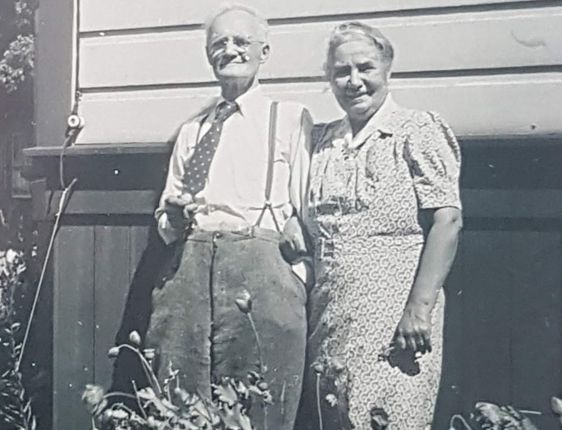 George and Helen Armstrong stand in a garden outside their house on Winnipeg's Dunkirk Drive in the 1930s. (Helen Armstrong fonds/Archives of Manitoba)